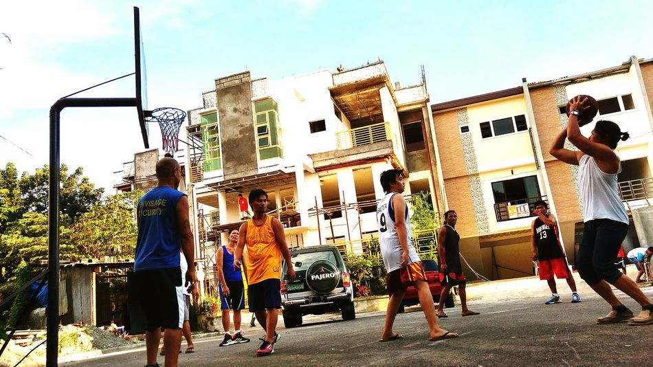 Outdoors Person In Front Of Streetbasketball Sky Day Casual Clothing Lifestyles Philippines Homecourt  People And Places.