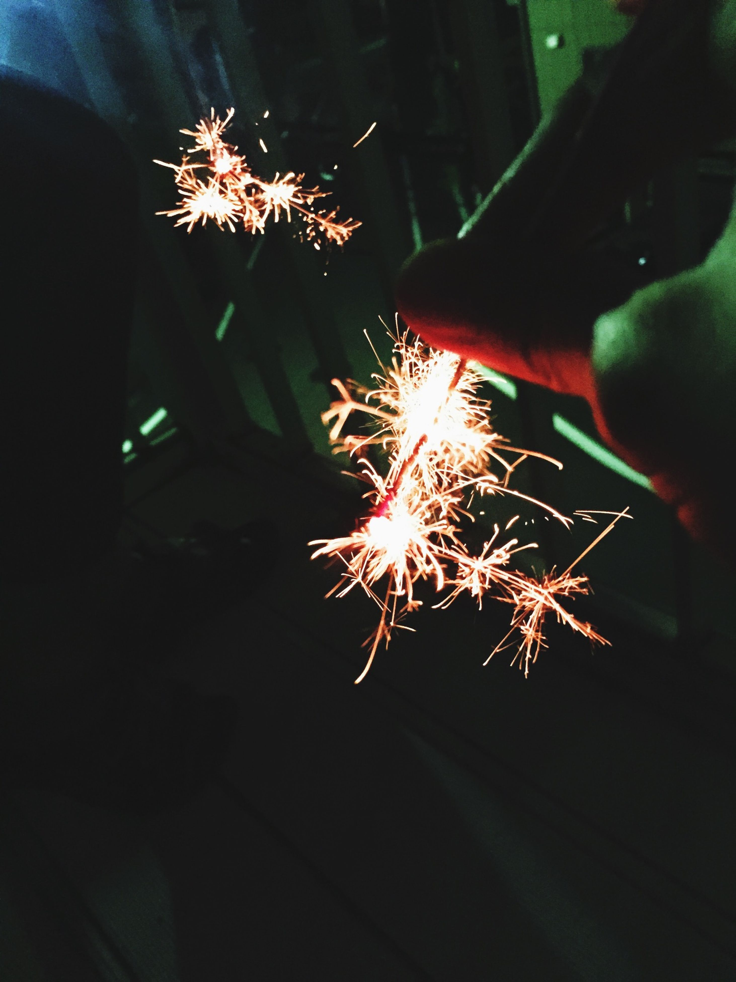 night, firework display, celebration, exploding, illuminated, firework - man made object, sparks, glowing, long exposure, fire - natural phenomenon, motion, event, low angle view, arts culture and entertainment, firework, blurred motion, burning, entertainment, celebration event, sky