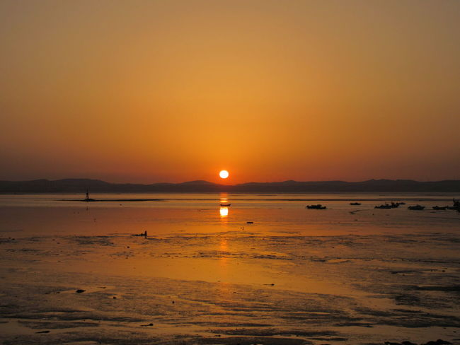 Skyonfire Water Sunset Tranquil Scene Orange Color Beauty In Nature