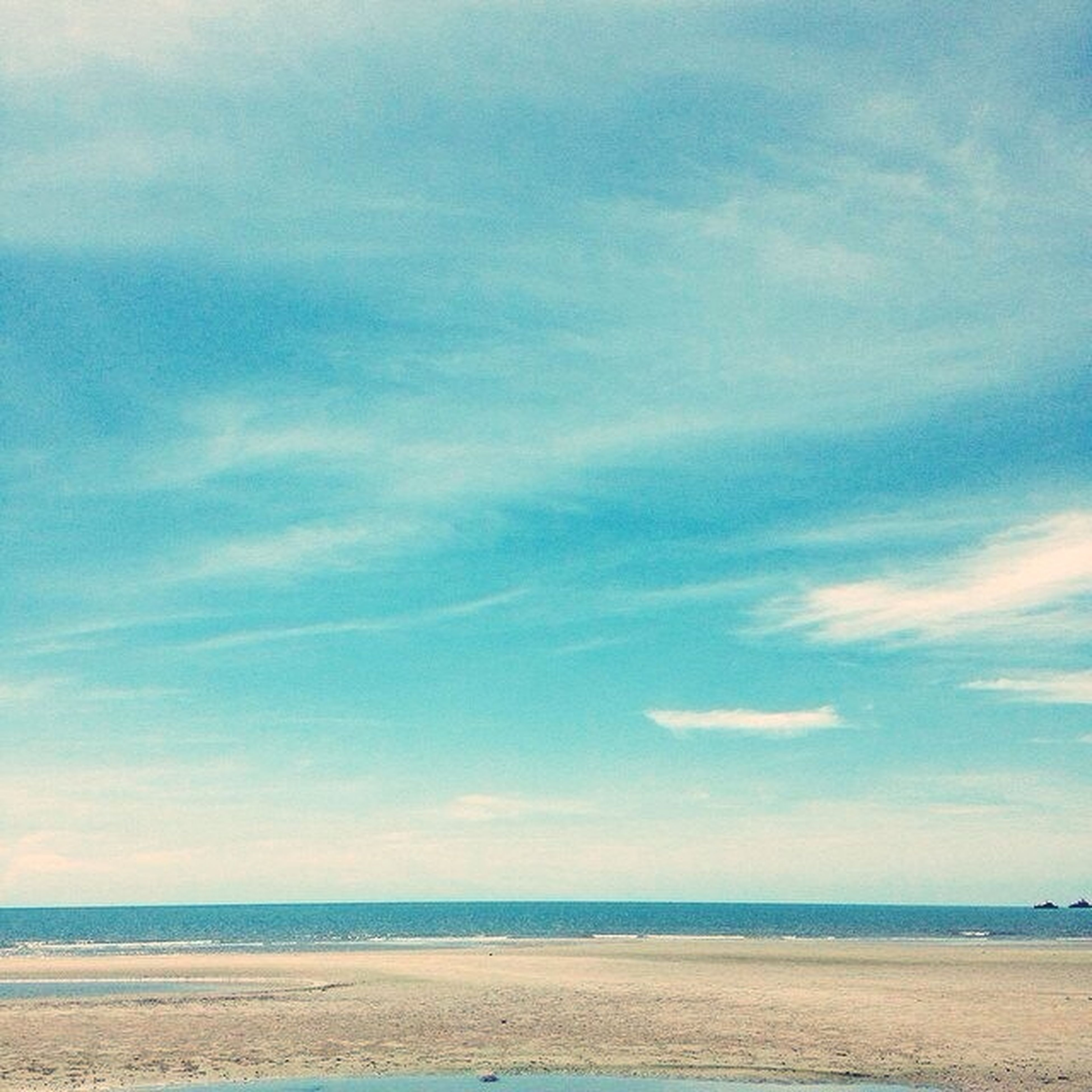 sea, horizon over water, beach, sky, tranquil scene, tranquility, scenics, water, beauty in nature, sand, shore, blue, nature, cloud - sky, cloud, idyllic, day, outdoors, remote, calm