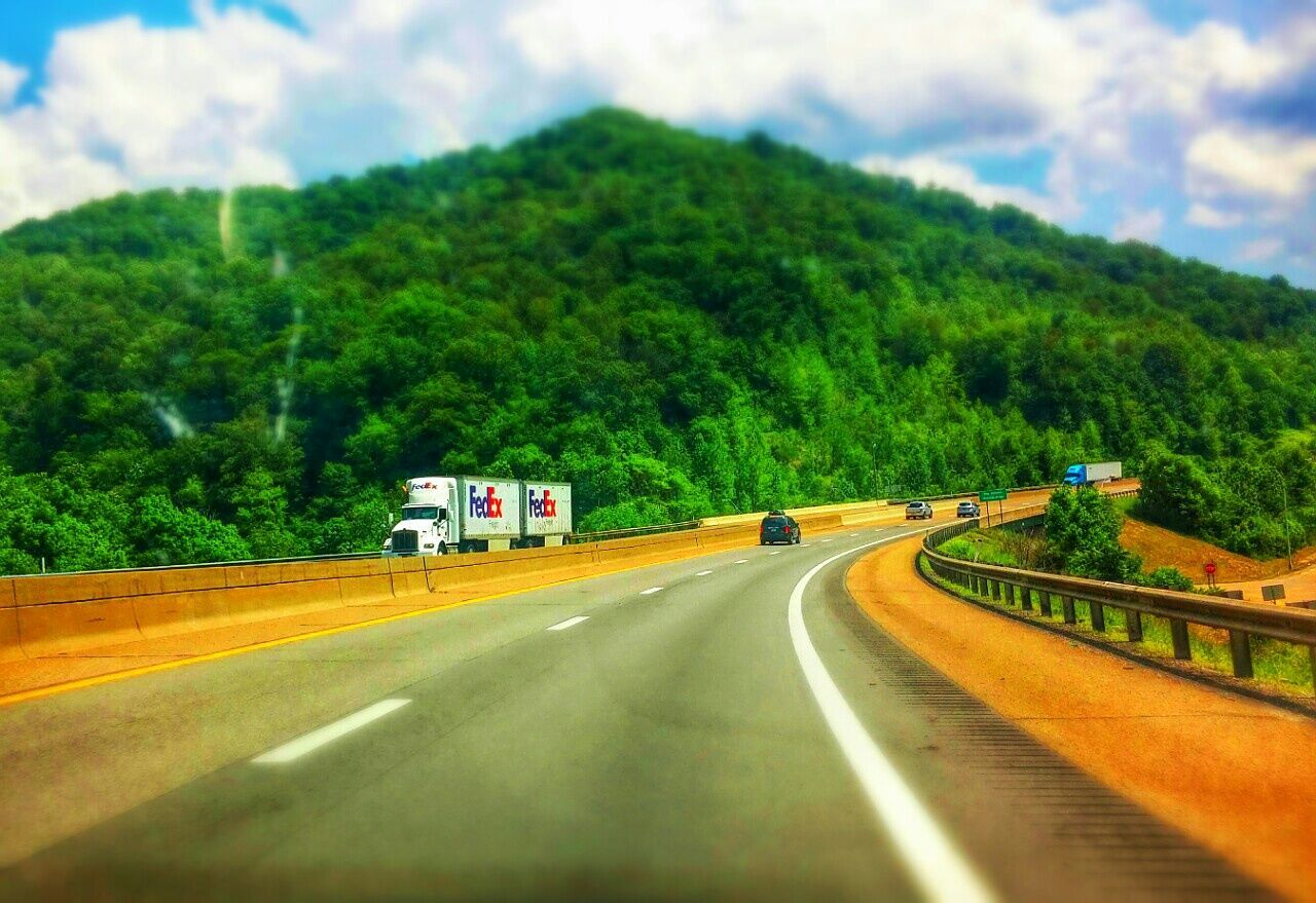 transportation, road, tree, mountain, the way forward, sky, cloud - sky, mode of transport, day, green color, no people, nature, landscape, outdoors, scenics, growth, beauty in nature