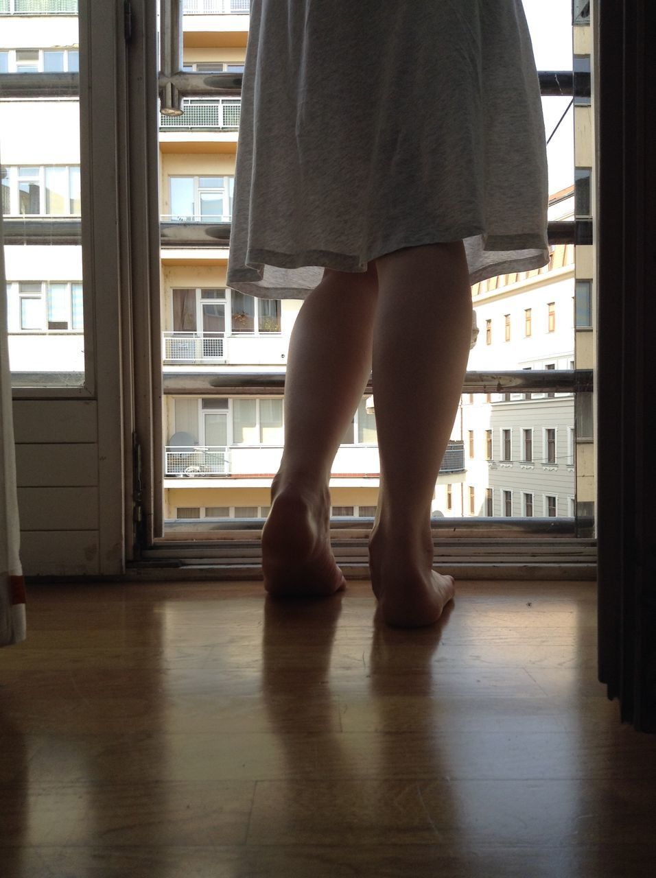 window, indoors, one person, standing, real people, low section, day, architecture, women, people