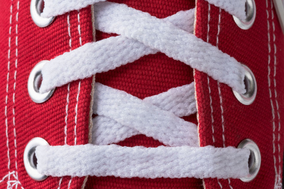 White laces on red canvas shoe Canvas Close-up Cloth Directly Above Fashion Footwear Laced Laced Up Laces No People Red Shoe Sneakers Tennis Shoe White