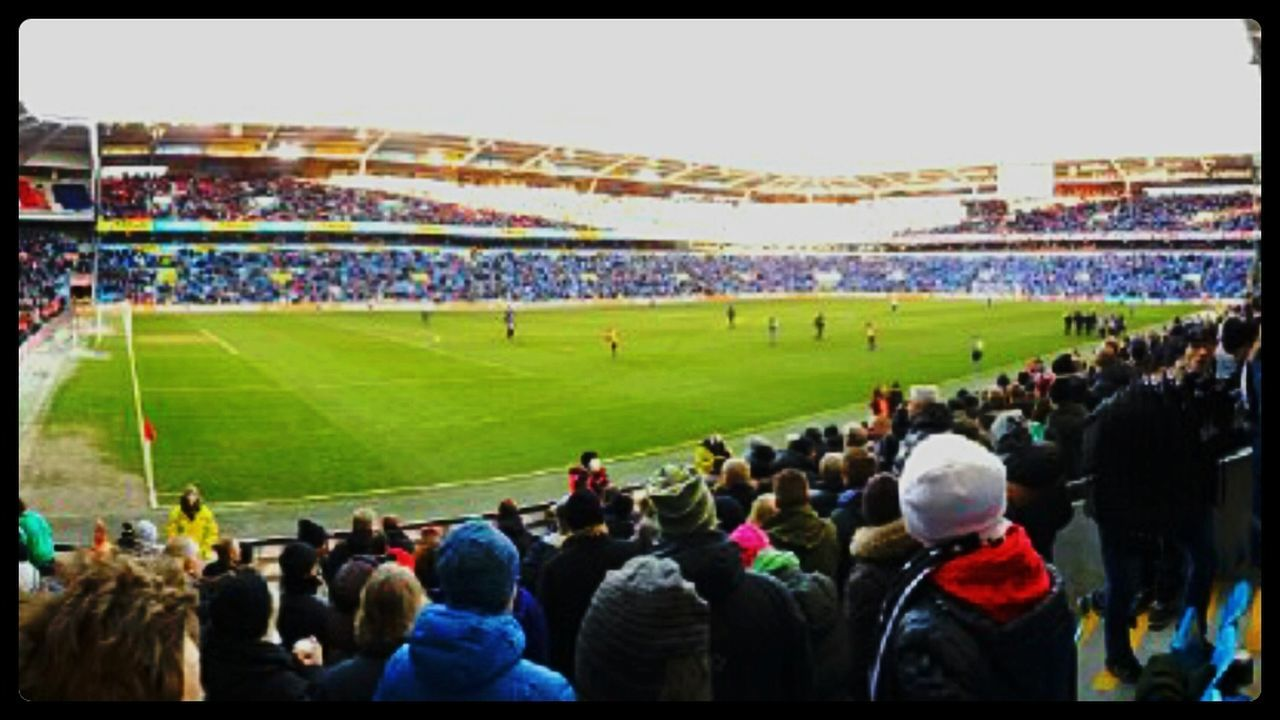 spectator, stadium, crowd, soccer, sport, large group of people, fan - enthusiast, audience, people, soccer field, soccer player, sports team, panoramic, adult, teamwork, sportsman, day, adults only, outdoors, only men