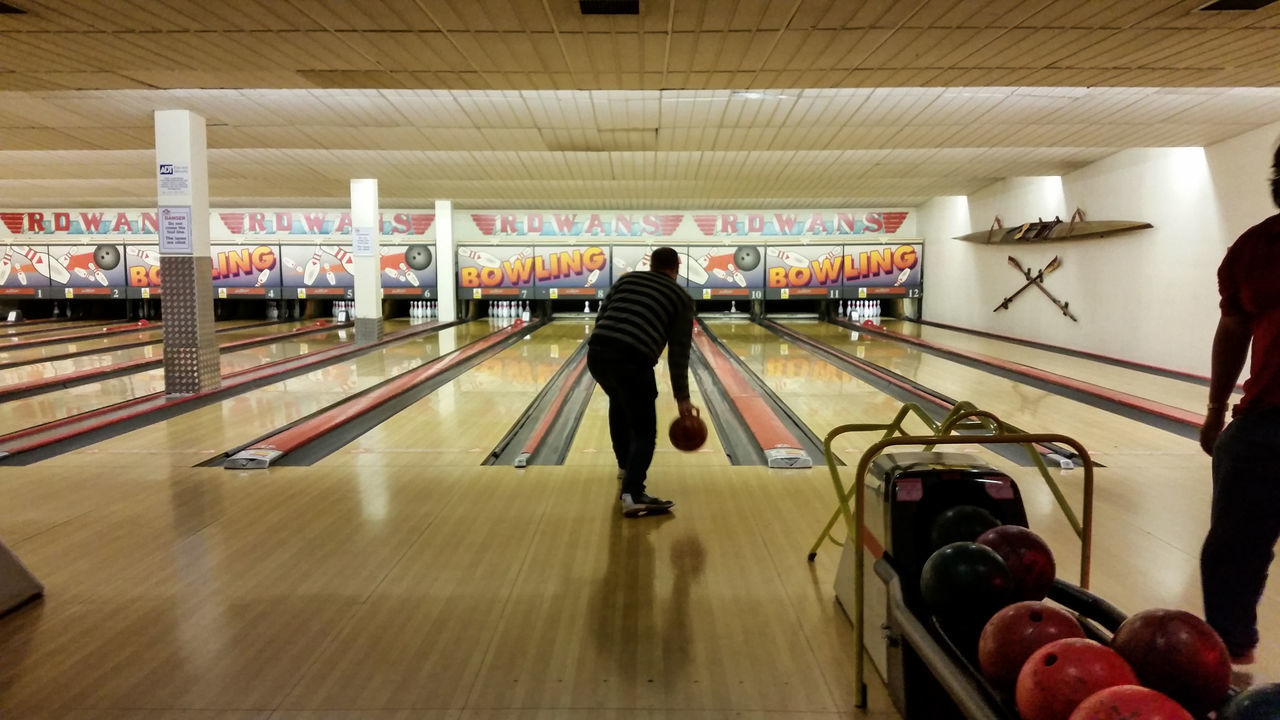 Adult Bowling Bowling Alley Day Full Length Horizontal Illuminated Indoors  Men One Man Only One Person Only Men People Person Real People Rear View