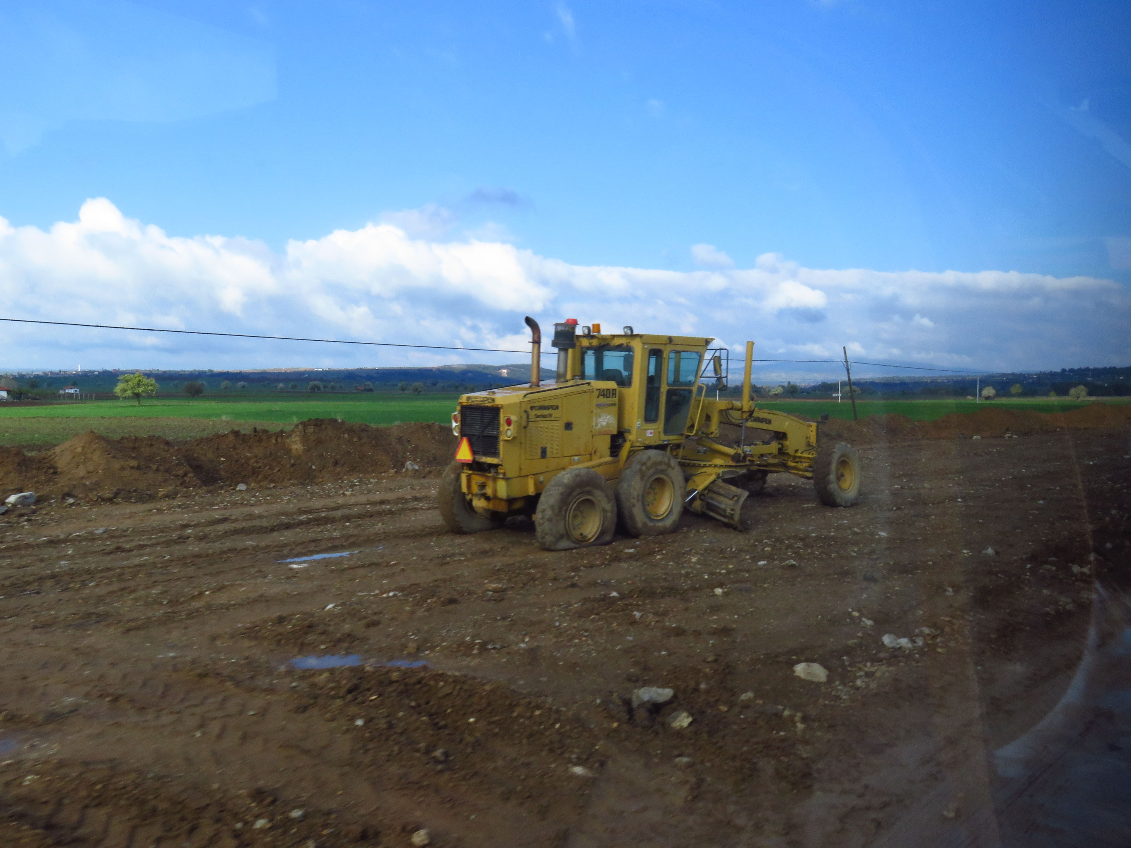 sky, cloud - sky, construction site, agricultural machinery, machinery, development, field, industry, day, construction machinery, transportation, landscape, outdoors, no people, nature, combine harvester