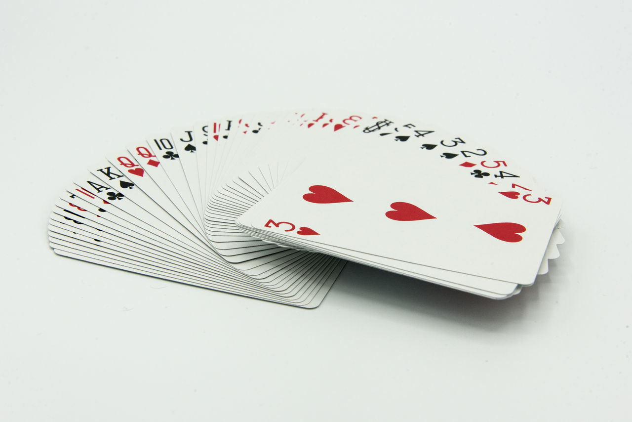 Cards Chance Close-up Day Gambling Gambling Chip Heart Shape Indoors  Leisure Games Luck No People Poker - Card Game Red Studio Shot Table White Background