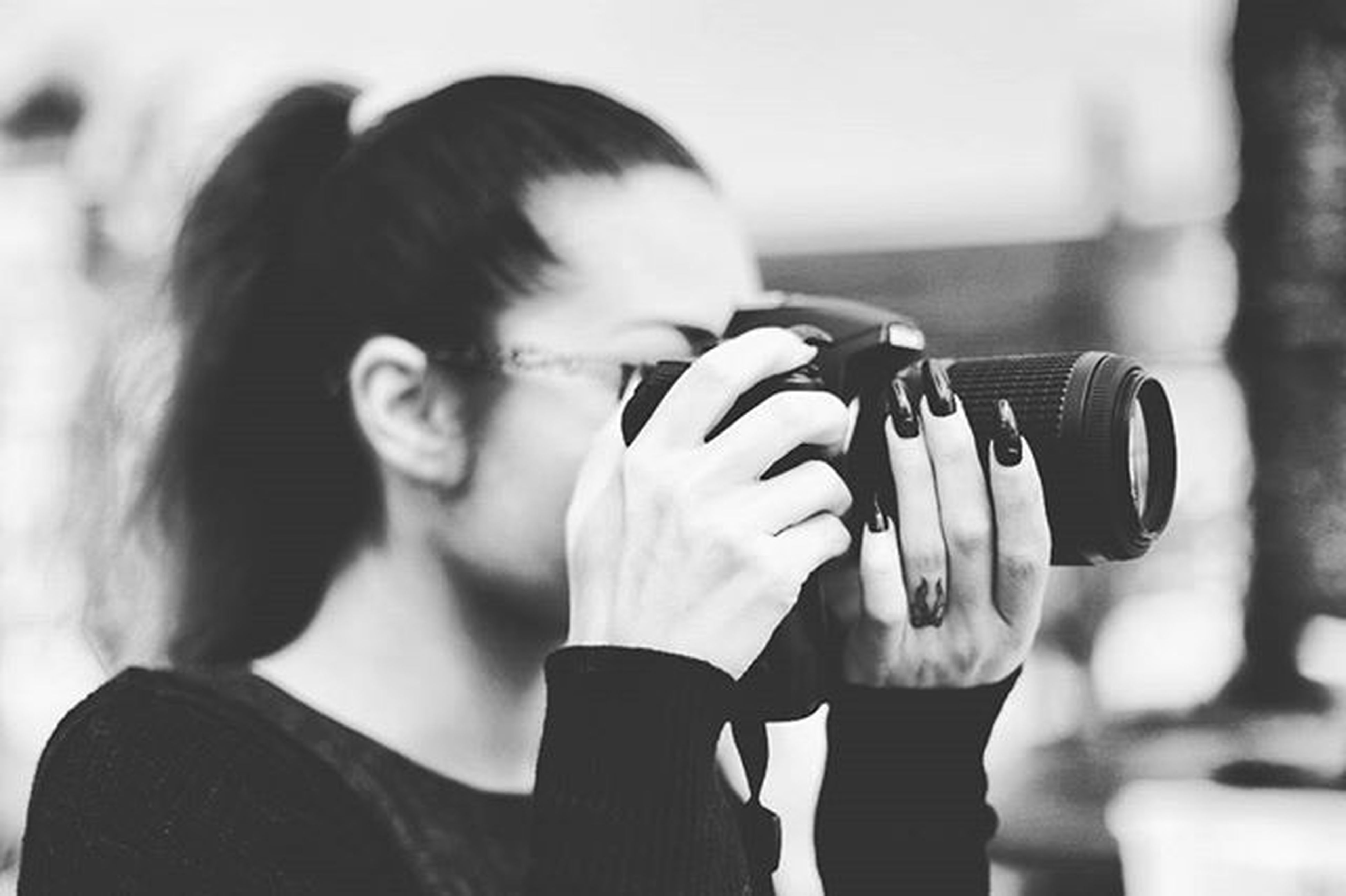 lifestyles, leisure activity, focus on foreground, standing, casual clothing, communication, technology, photography themes, holding, waist up, three quarter length, person, photographing, indoors, wireless technology, smart phone, young adult, headshot