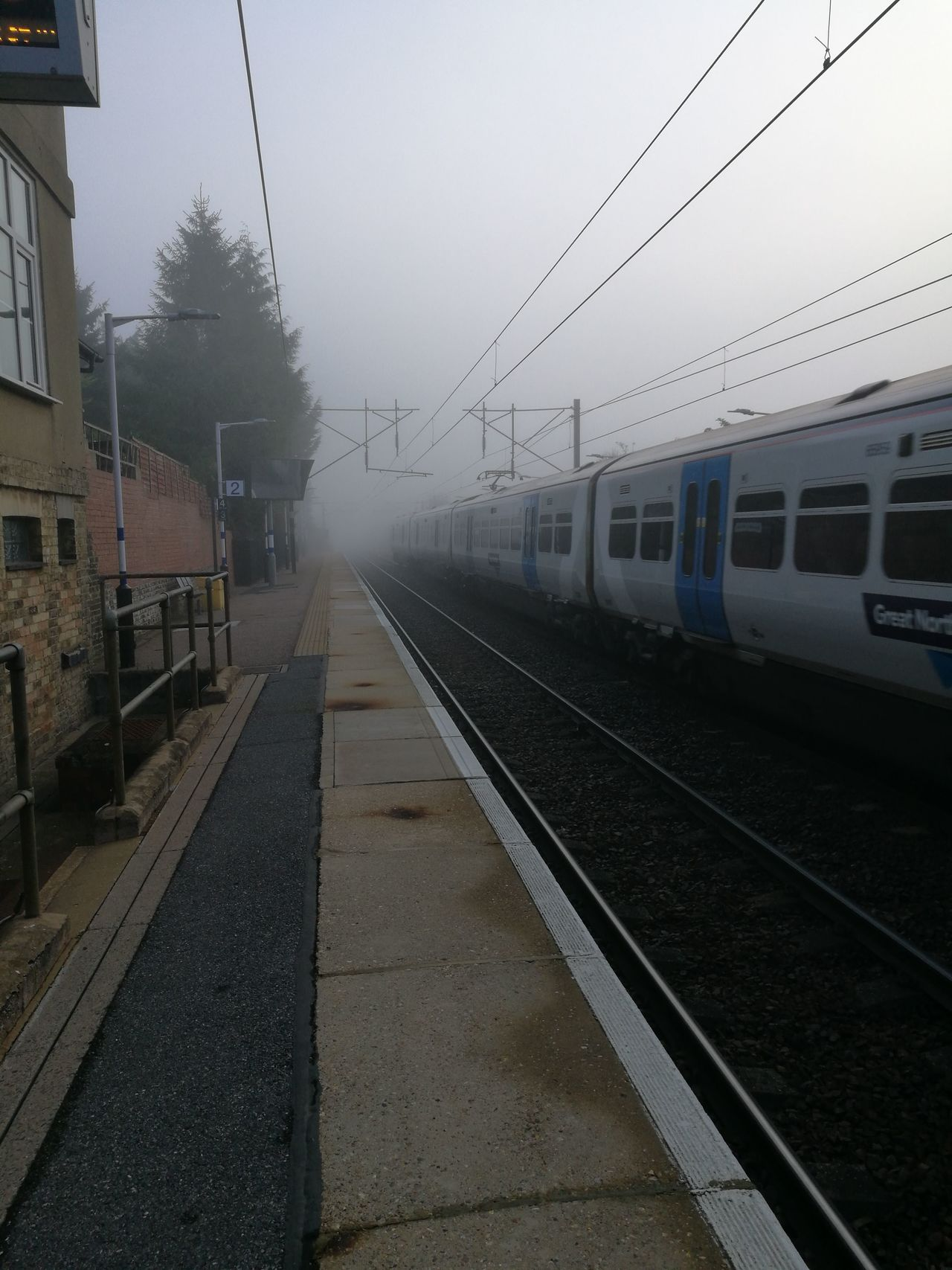 Transportation Rail Transportation Railroad Track Train - Vehicle Mode Of Transport Rain Railroad Station Horizontal Public Transportation Railroad Station Platform Outdoors City Sky Fog No People Day Foggy Morning Cable Train Line Train