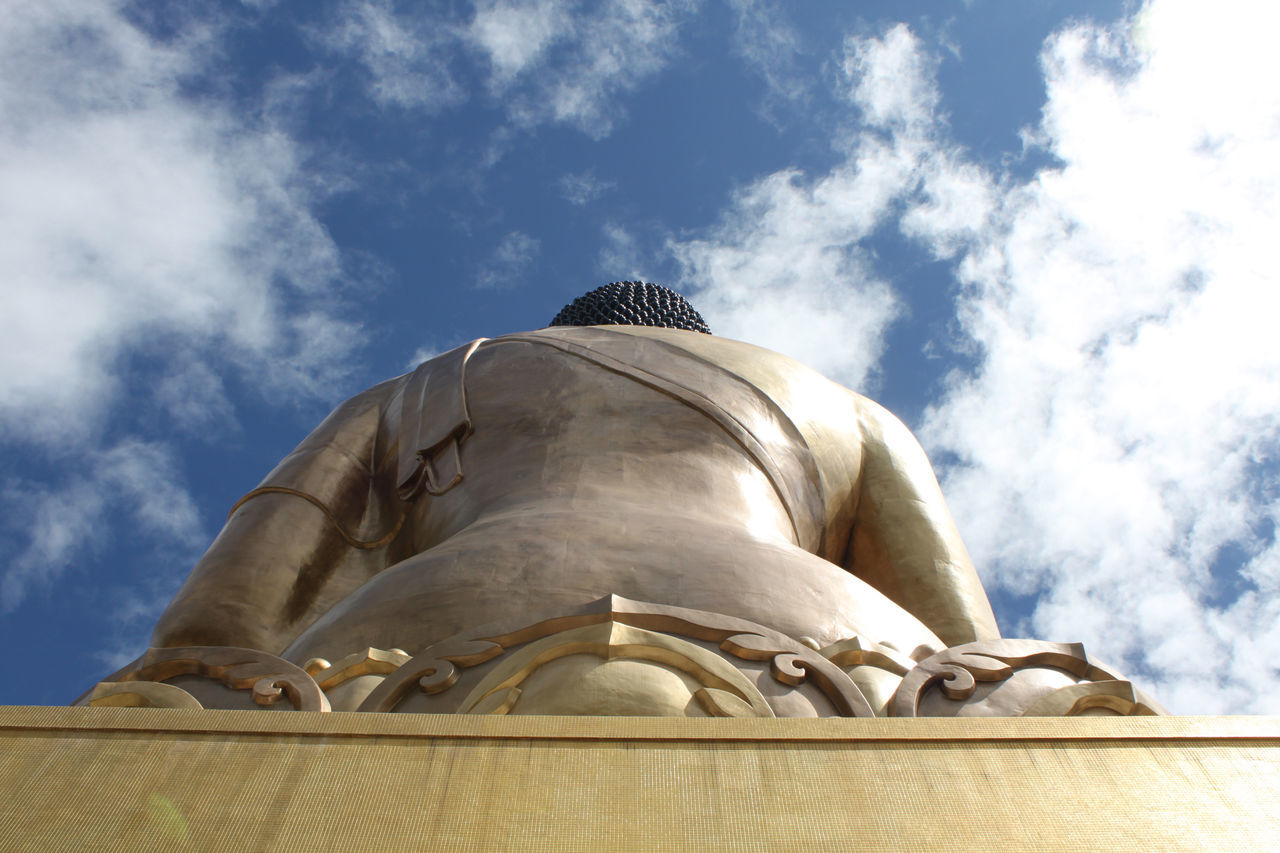 low angle view, statue, cloud - sky, sculpture, sky, human representation, spirituality, day, no people, outdoors