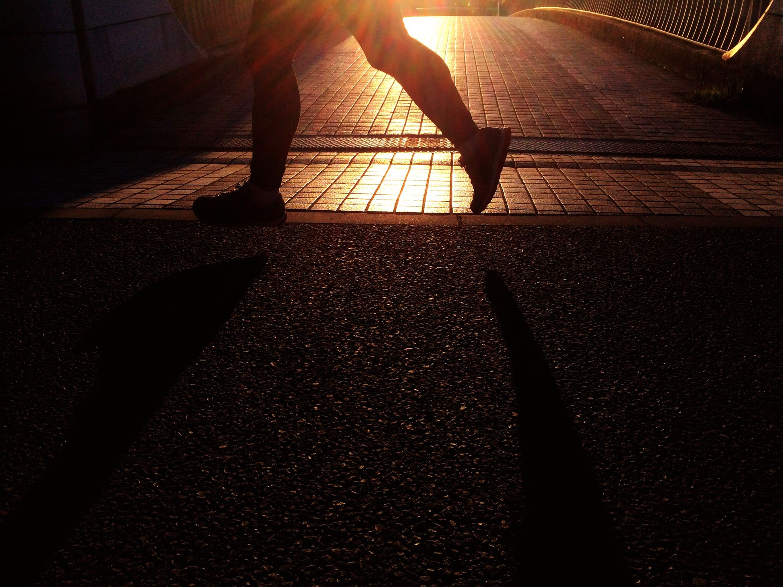 low section, person, lifestyles, silhouette, shadow, sunlight, leisure activity, men, unrecognizable person, walking, indoors, standing, human foot, street, part of, steps