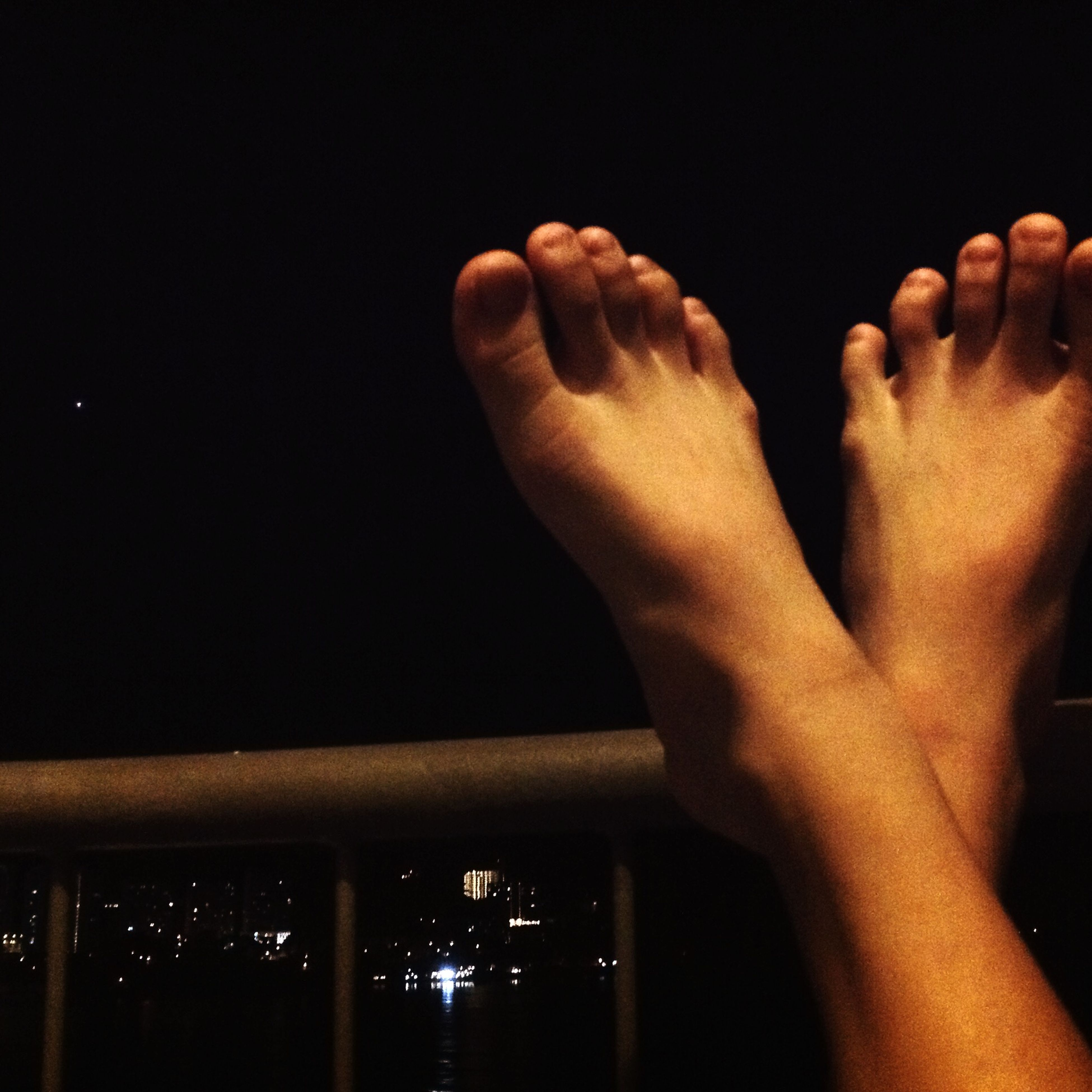 person, part of, human finger, indoors, lifestyles, personal perspective, cropped, leisure activity, unrecognizable person, men, close-up, barefoot, human foot, holding, silhouette
