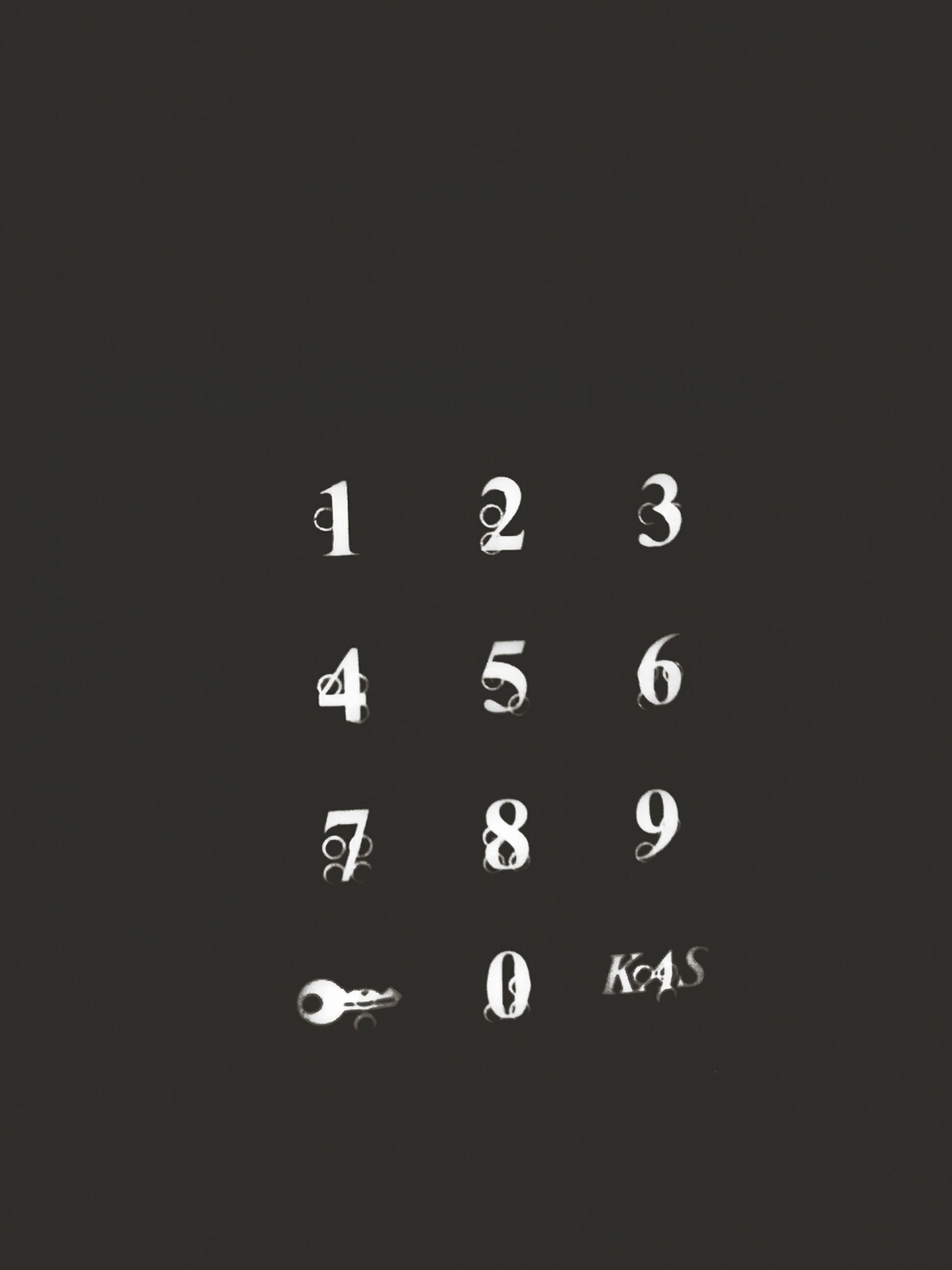 number, copy space, indoors, studio shot, communication, technology, close-up, text, illuminated, no people, control, western script, night, time, connection, black background, circle, clock, metal, electricity