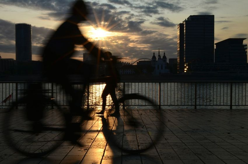 Köln summer time. Reflection City Sky Architecture Urban Skyline Outdoors Shadow CreativePhotographer Lights City Light Coincidence Or Accident Blury Blurred Motion Motion Motion Blur Bycicle Dawn Dawn Of A New Day Sunlight Summer Sunshine Summertime Water Cloud - Sky
