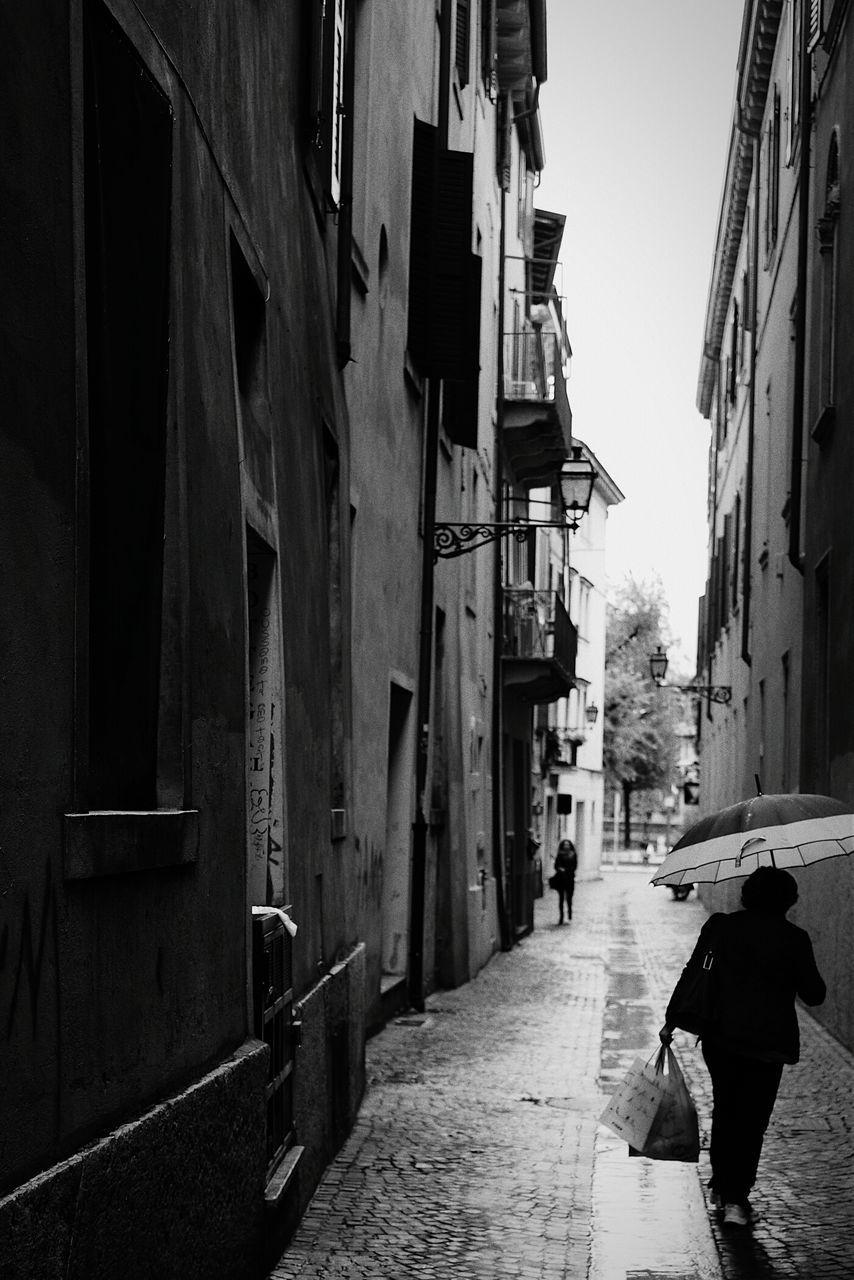 Woman Walking On Street Road