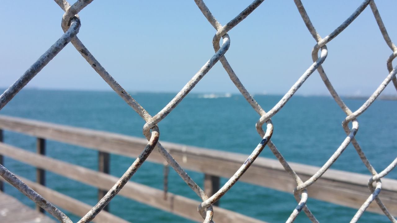 Focus On Foreground Natural Light No Edit Chainlink Chainlink Fence Metal Sky Pattern Full Frame Backgrounds Sea Outdoors Water Sunlight Simplicity Fine Art Photgraphy Still Life Photography Copy Space Check This Out Eyem Gallery Eye Em Nature Lover Enjoying Life Weathered Rusted