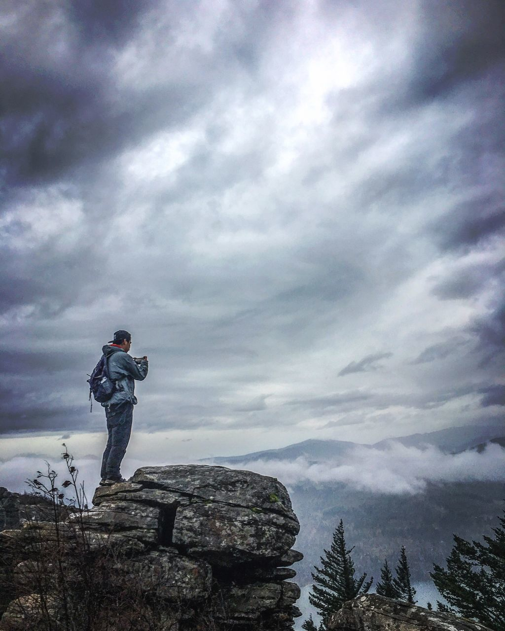 cloud - sky, full length, standing, sky, real people, leisure activity, one person, lifestyles, outdoors, day, nature, men, low angle view, scenics, beauty in nature, mountain, young adult, people