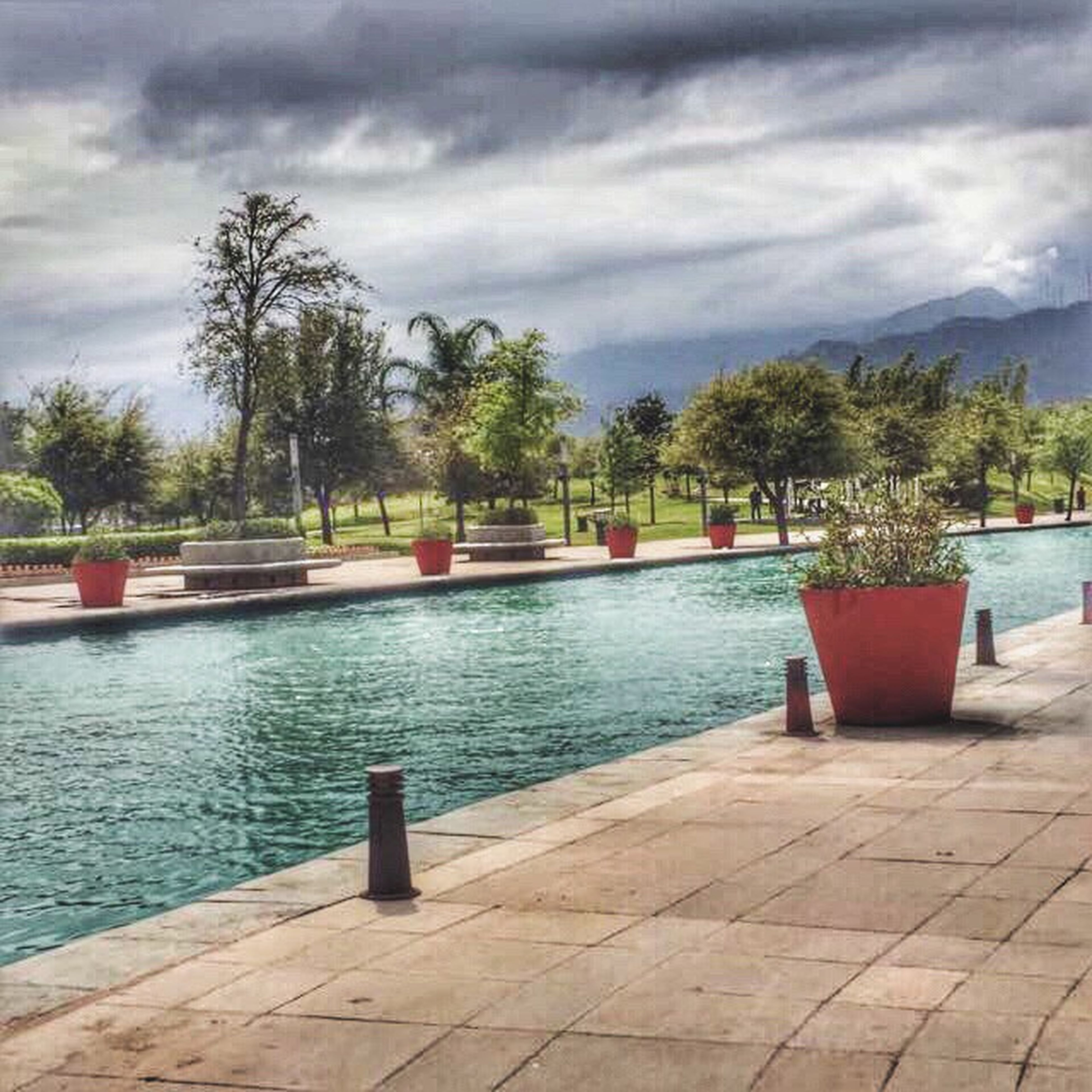swimming pool, tree, sky, water, cloud - sky, no people, outdoors, day, vacations, nature