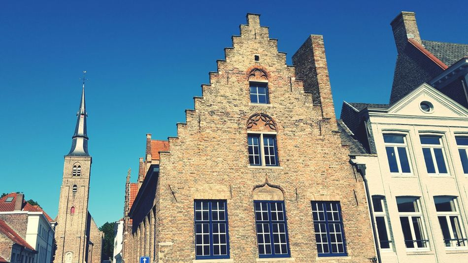 Architecture Blue Business Finance And Industry Clear Sky City No People History Place Of Worship Travel Destinations Sky Building Exterior Built Structure Outdoors Flandres  Flanders Bruges Brugge Cityscape Cultures Architecture Day
