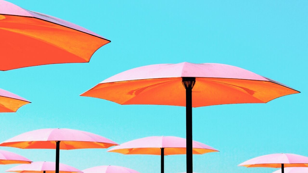 Beautifully Organized Multi Colored Blue Sky Outdoors Beach Umbrella No People Beauty In Nature Clear Sky Day
