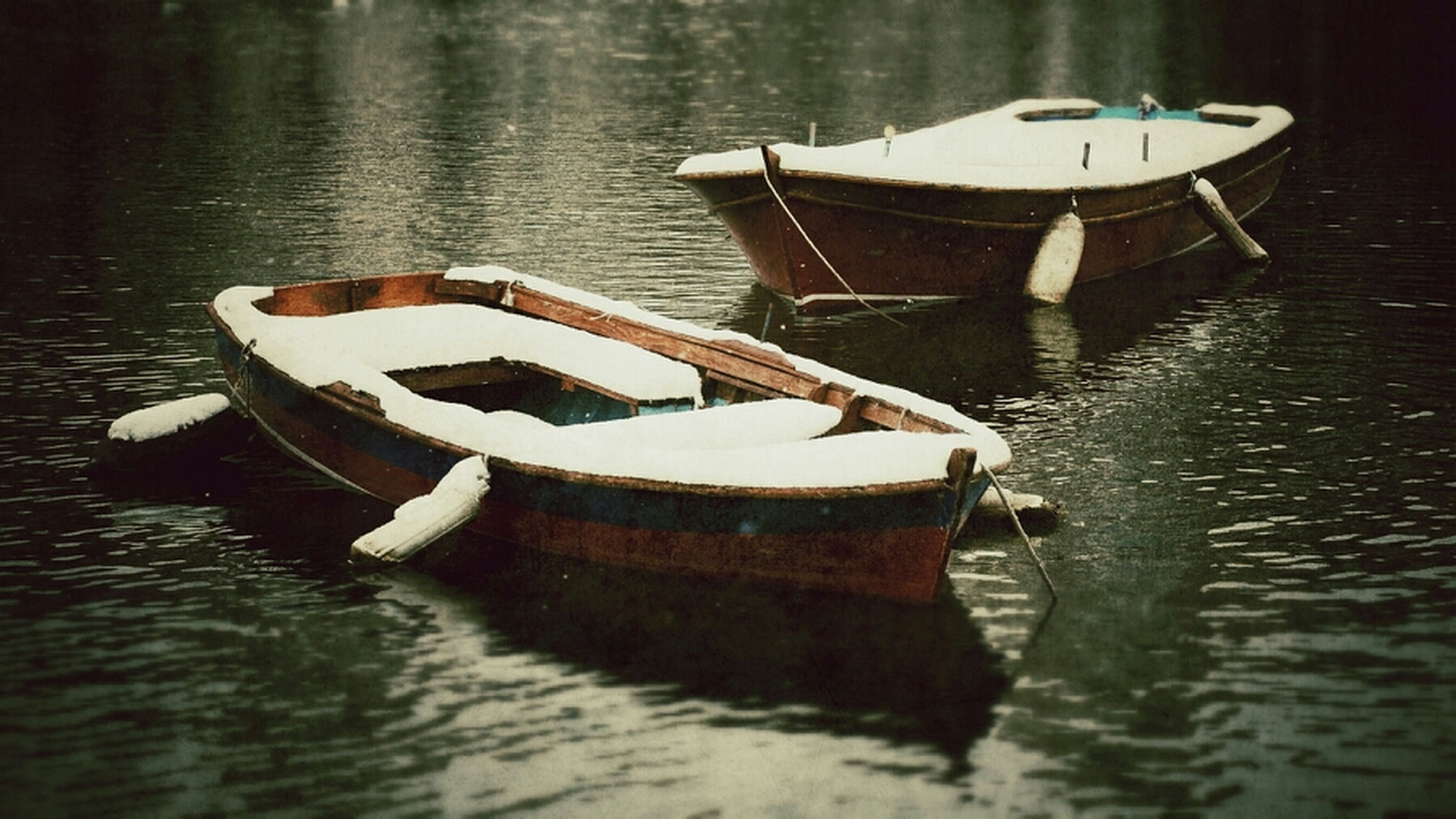 water, nautical vessel, boat, waterfront, transportation, moored, lake, mode of transport, reflection, rippled, rope, river, no people, wood - material, day, rowboat, outdoors, tranquility, nature, oar