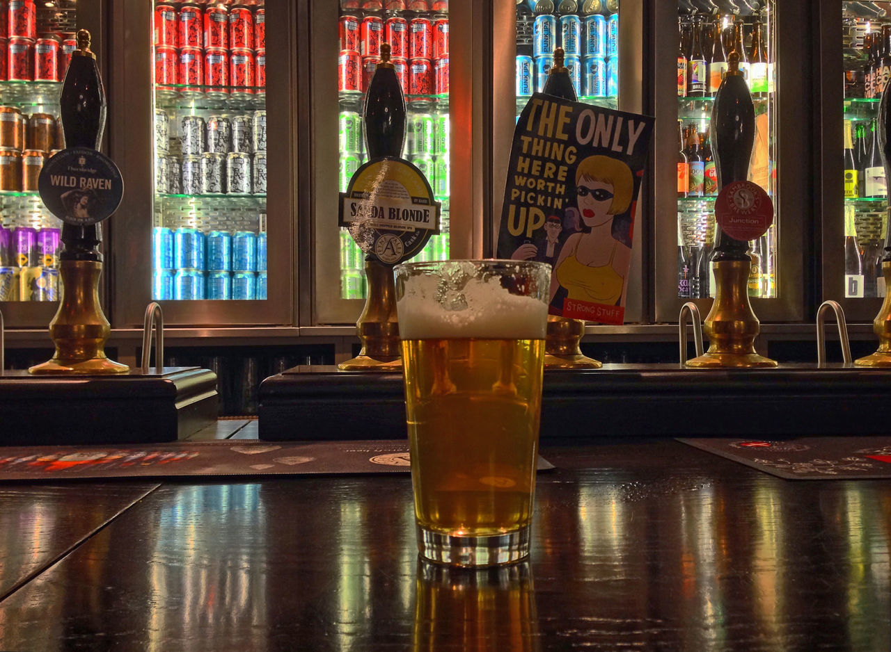alcohol, beer glass, drink, beer - alcohol, table, drinking glass, beer, bar - drink establishment, refreshment, indoors, food and drink, no people, frothy drink, day, close-up