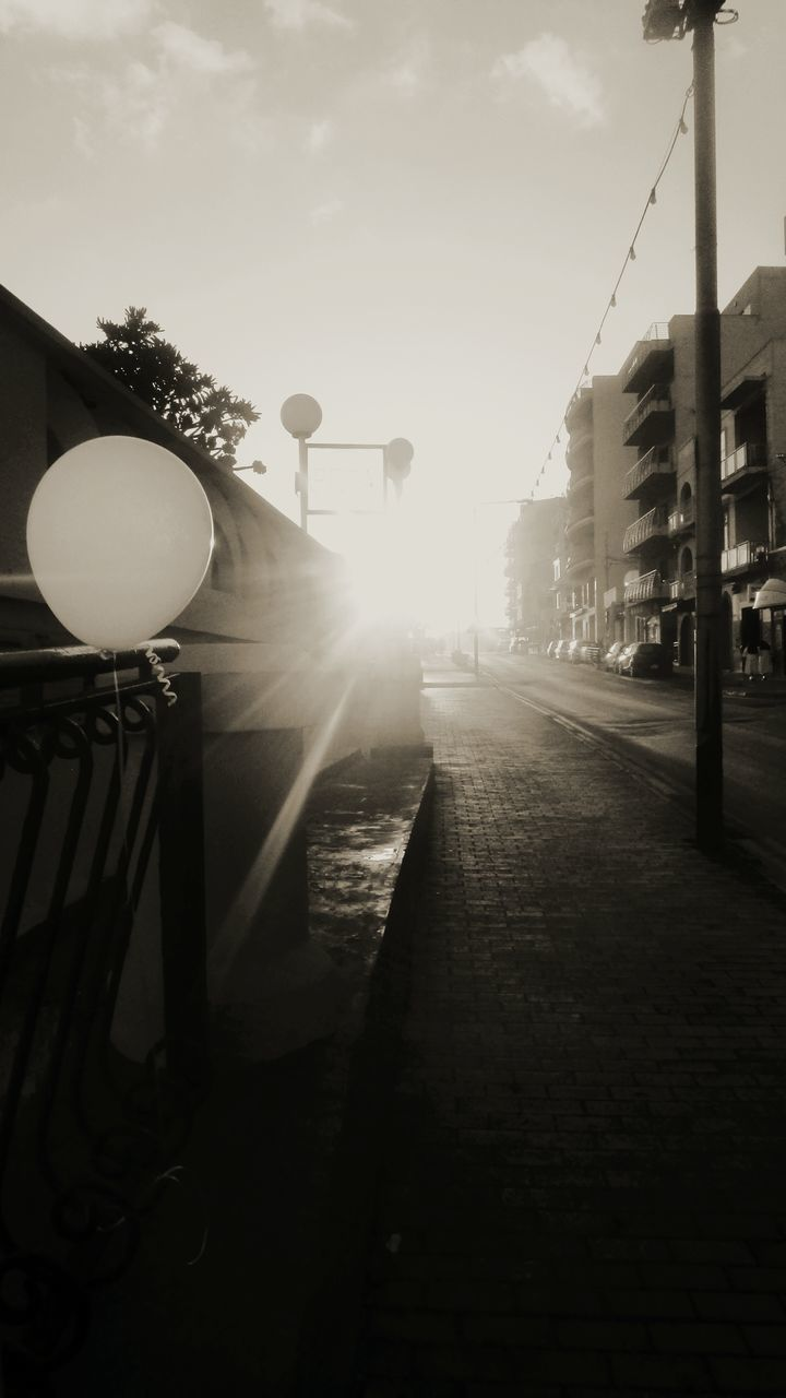 sunlight, outdoors, architecture, built structure, street light, no people, building exterior, sky, day