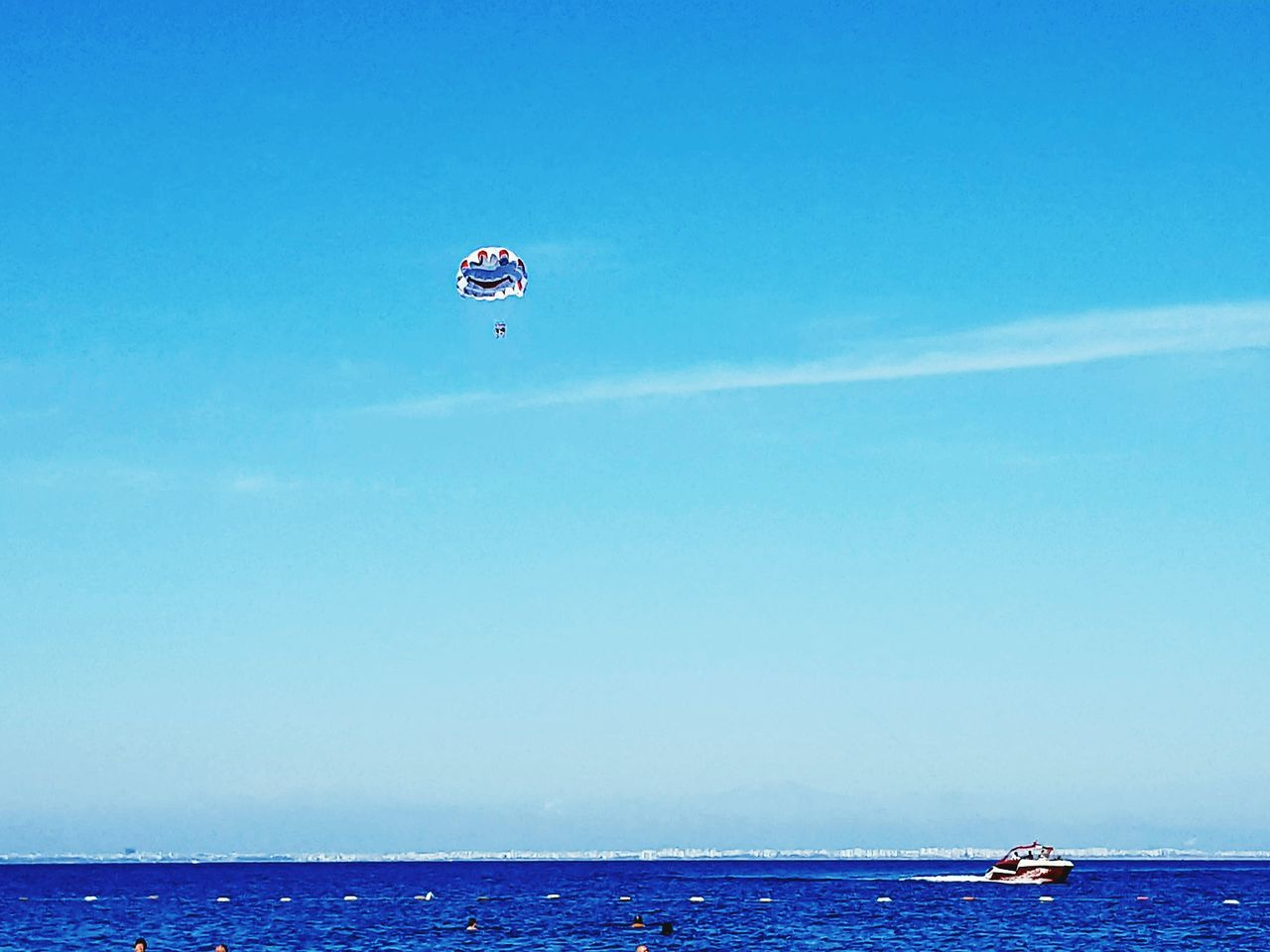 sea, day, horizon over water, nature, water, outdoors, sky, blue, clear sky, scenics, beauty in nature, nautical vessel, men, parachute, people