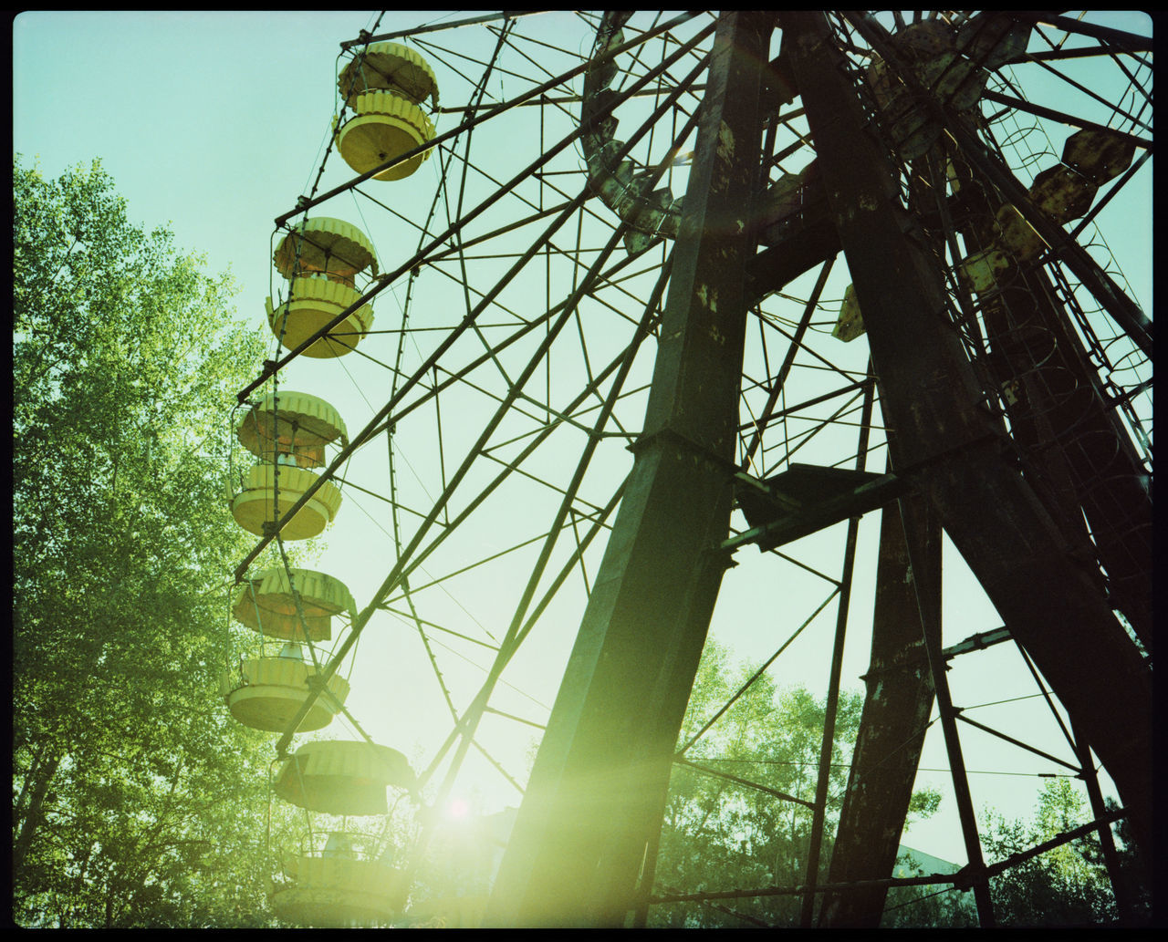 The Grotesque of Pripyat Abandoned Amusement Park Abandoned Hospital Analogue Photography Anbandoned Fun Park Broken Ferris Wheel Despair Evacuation Ferris Wheel Ferris Wheel And Trees Ferris Wheel Summer Flare Ferris Wheel Giant Wheel Gondula Nuclear Disaster Outdoors Plaubel Makina 67 Pripyat Pripyat Amusement Park Pripyat Chernobyl Pripyat Ferris Wheel Pripyat Hospital Recreation  Soviet Union Sunshine Ferris Wheel Ukraine The Photojournalist - 2017 EyeEm Awards