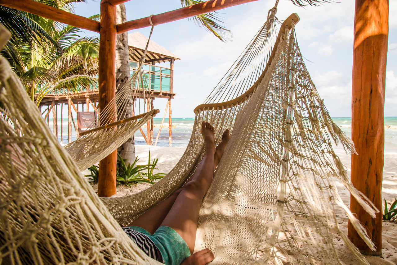 Legs of a young woman relaxing in a hammock on a beach #bare F #dreamvacation #feet #flower#garden#nature#ecuador#santodomingoecuador#eyeEmfollowers#iphoneonly#nofiltrer#macro_garden#pretty#beautiful#followme#sho #lazyday #Relaxing #sunset #sun #clouds #skylovers #sky #nature #beautifulinnature #naturalbeauty #photography #landscape #young Girl Beach Day Hammock Hanging JustMe Nature One Person Outdoors Palm Tree Sea Sky Vacations