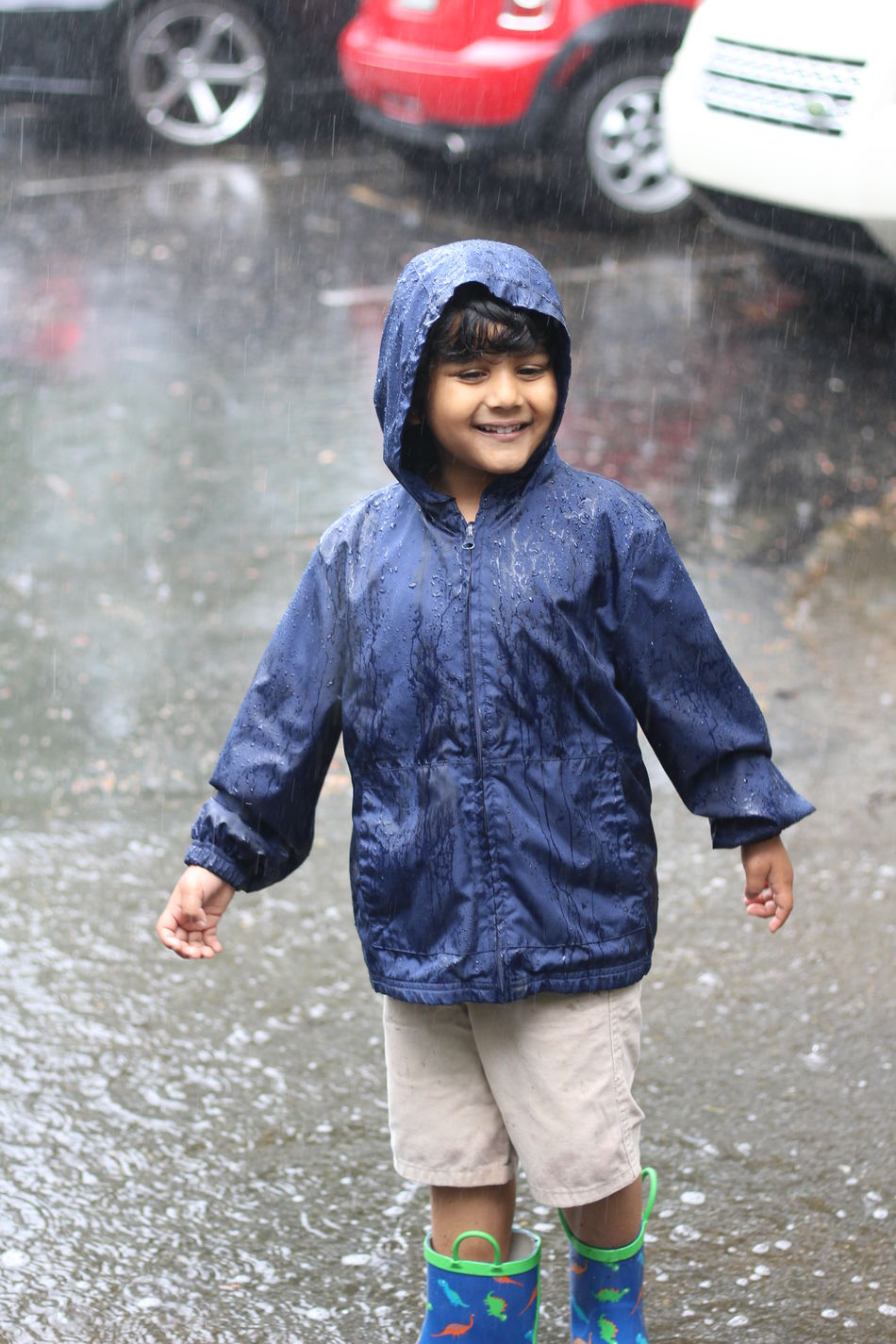 Boys Childhood Day Front View Full Length Happiness Lifestyles Looking At Camera One Boy Only One Person Outdoors People Portrait Rain Real People Smiling Standing Warm Clothing Weather Wet