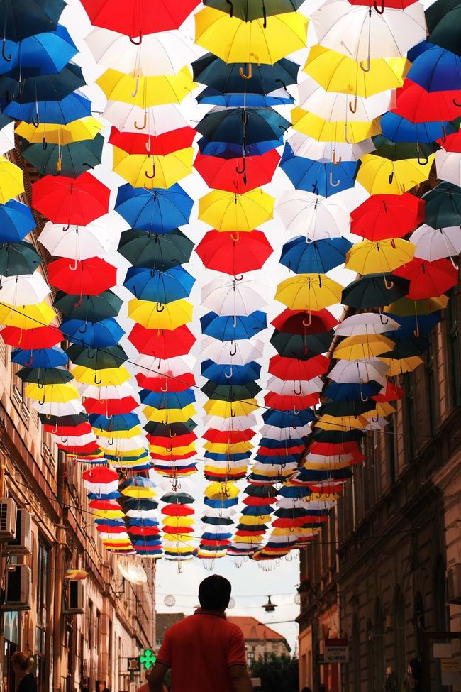 Colorful protection... Tourist Attraction  Fun Found On The Roll My Favorite Photo Made In Romania Color Palette Colour Of Life Tranquil Scene Vscocam Enjoying Life Close-up Umbrellas Colorful Unrecognizable Person Streetart City Street City Life Tourism Travel Outdoor Photography Travel Destinations EyeEm Best Shots Architecture What's On The Roll Pivotal Ideas