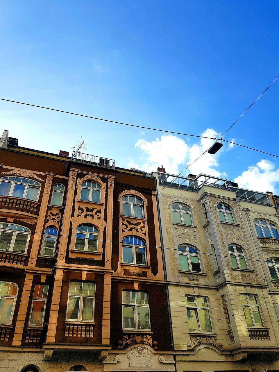 low angle view, architecture, built structure, no people, day, building exterior, window, sky, outdoors, cable, blue