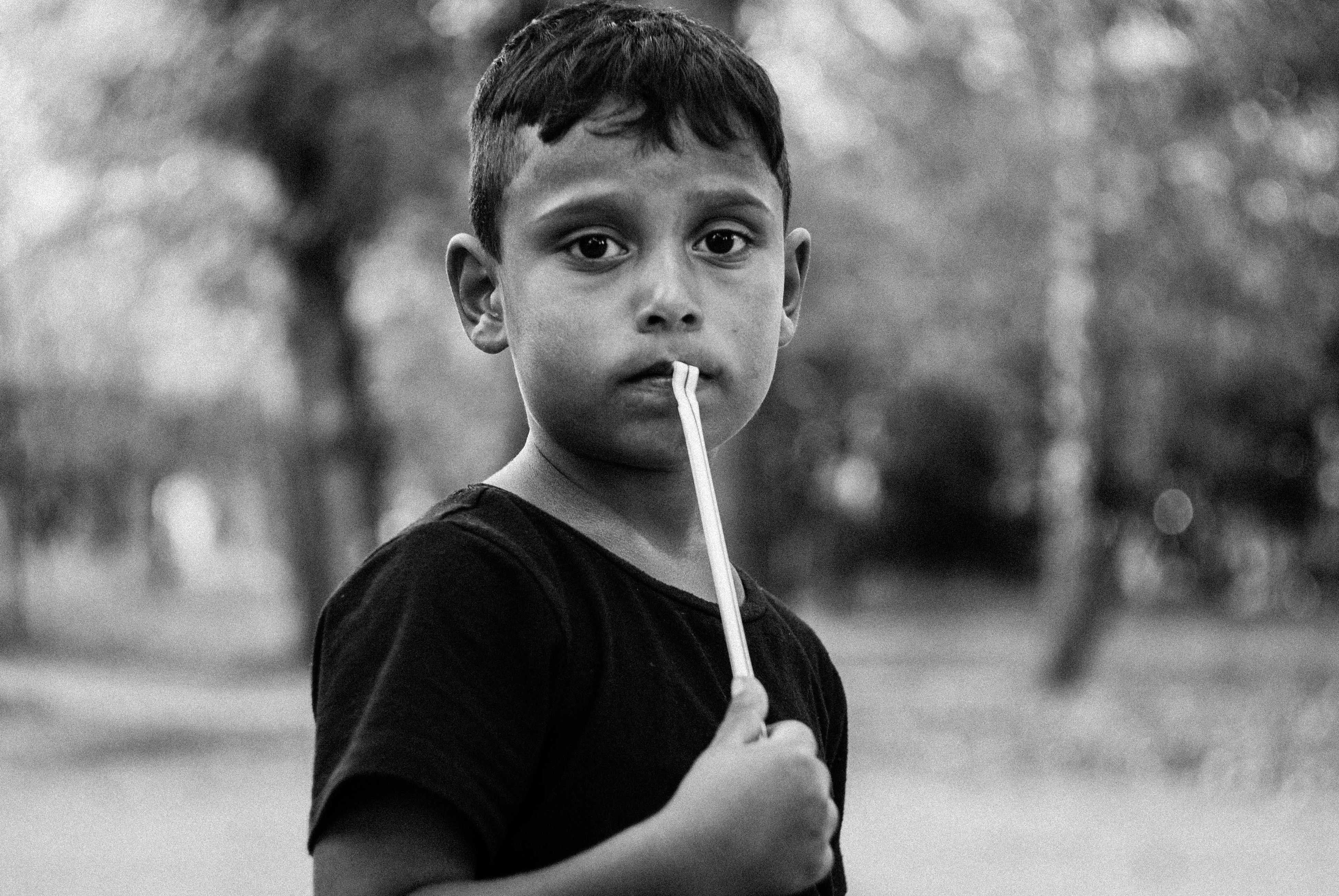 boys, childhood, one person, real people, focus on foreground, looking at camera, casual clothing, outdoors, one boy only, child, headshot, portrait, children only, lifestyles, day, tree, people
