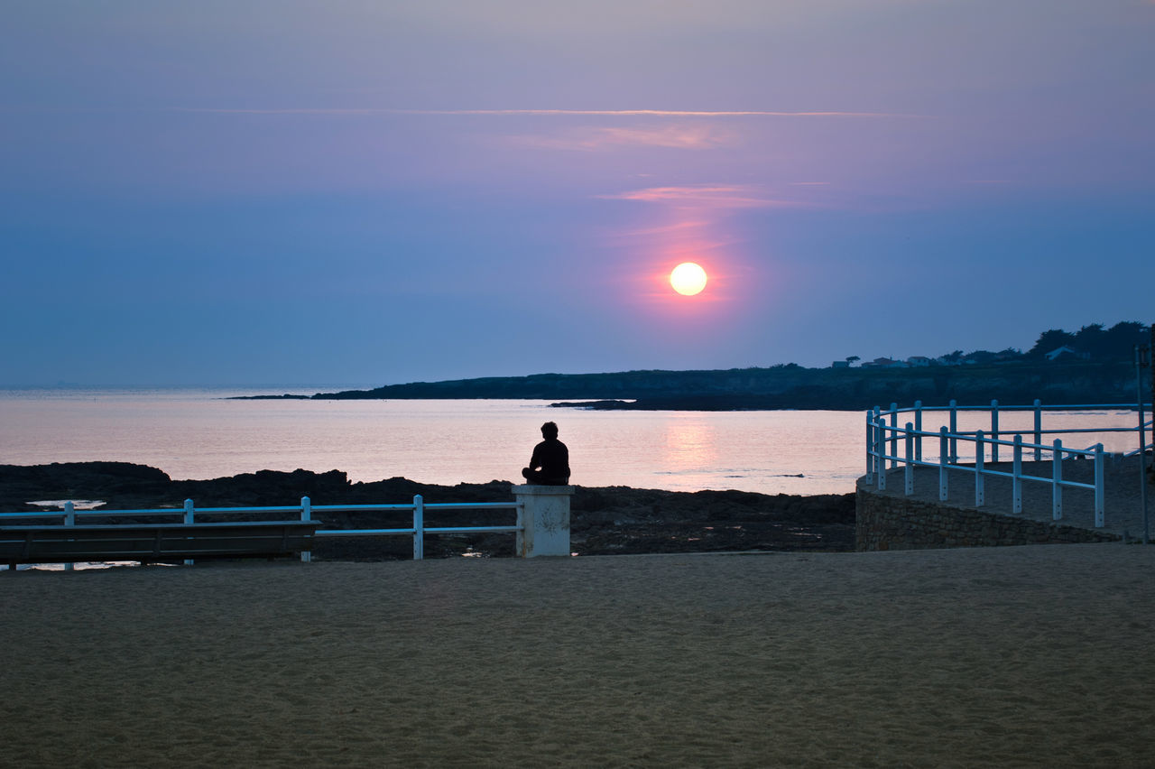 Sunset on the beach and loneliness, autumn is coming. Préfailles. France. Beach Beauty In Nature Clear Sky Day France Horizon Over Water Nature Ocean One Person Outdoors People Prefailles Real People Sand Scenics Sea Silhouette Sky Standing Sunset Tranquil Scene Tranquility Water