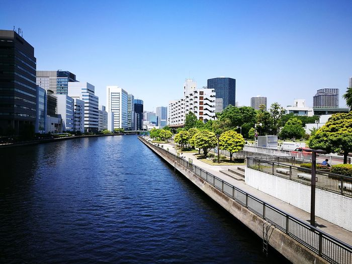 Architecture Skyscraper City Building Exterior Cityscape Urban Skyline Built Structure City Life Modern Apartment Clear Sky No People Downtown District Outdoors Day Water Sky Tree Canal Takahama-unga Minato-ku, TOKYO Japan Rakusui Bashi