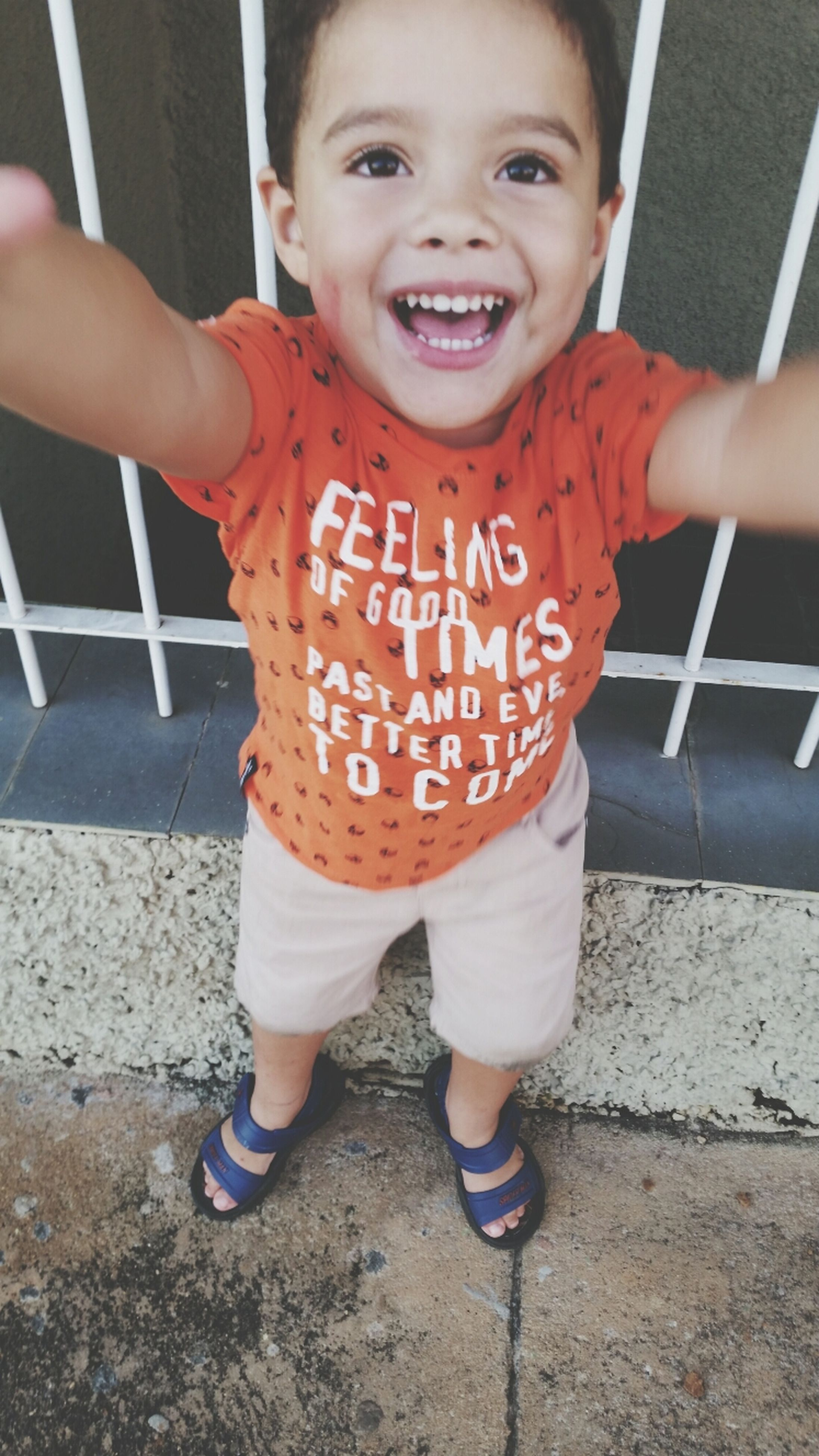person, childhood, elementary age, lifestyles, casual clothing, boys, leisure activity, front view, cute, portrait, holding, happiness, looking at camera, standing, innocence, communication, smiling, three quarter length