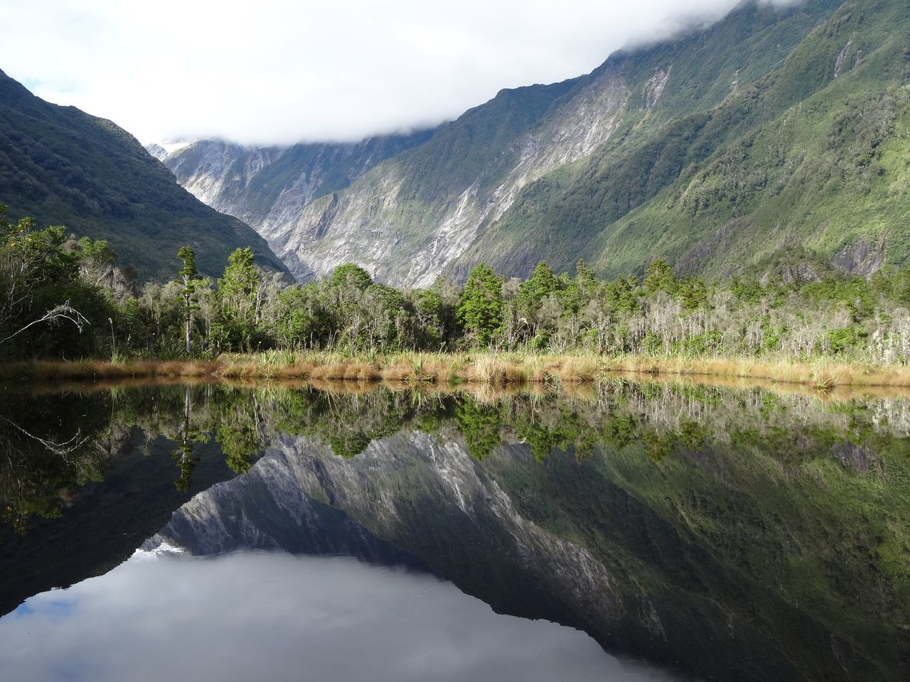 Reflection Water Mountain Nature Scenics No People Beauty In Nature Idyllic Mountain Range Sky Tranquil Scene Tranquility Outdoors Day Tree Water Reflections Franz Josef Glacier Mirror Lake New Zealand Symmetry Lake