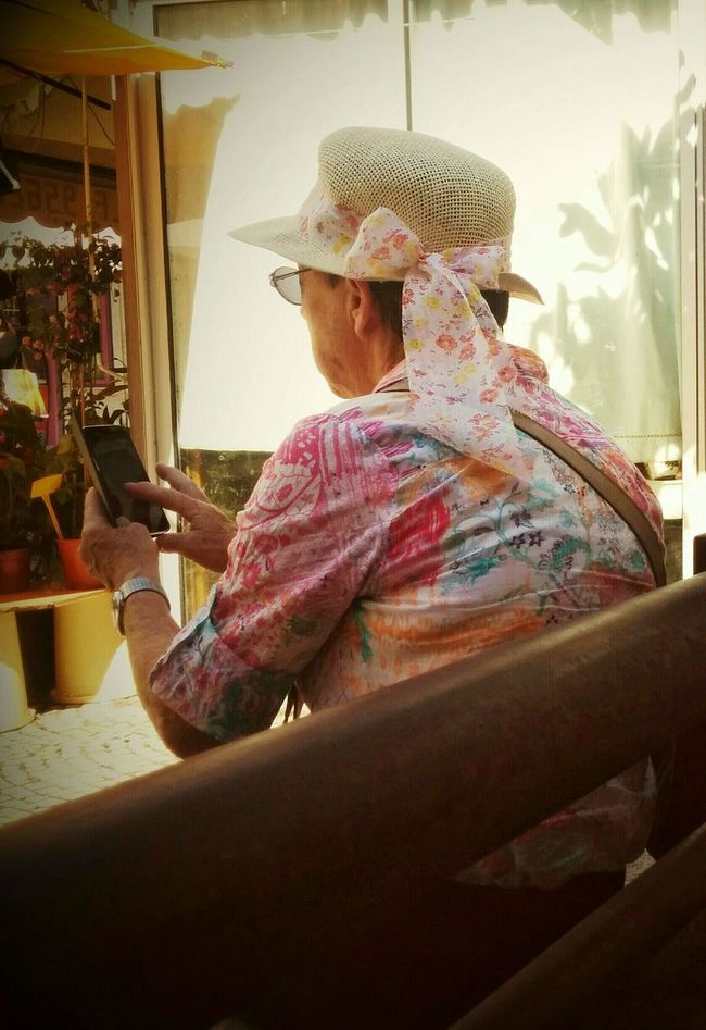 Cute Old Lady using a Smartphone. Today's Generation People With Smartphones