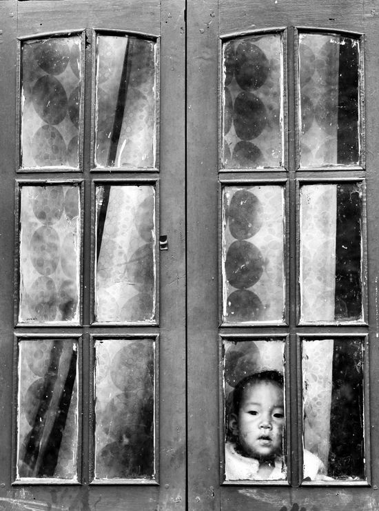 Lil Himalayan boy gazing through the window while mother away doing usual chores Himalayanwonders Sikkim First Eyeem Photo Monochrome Photography