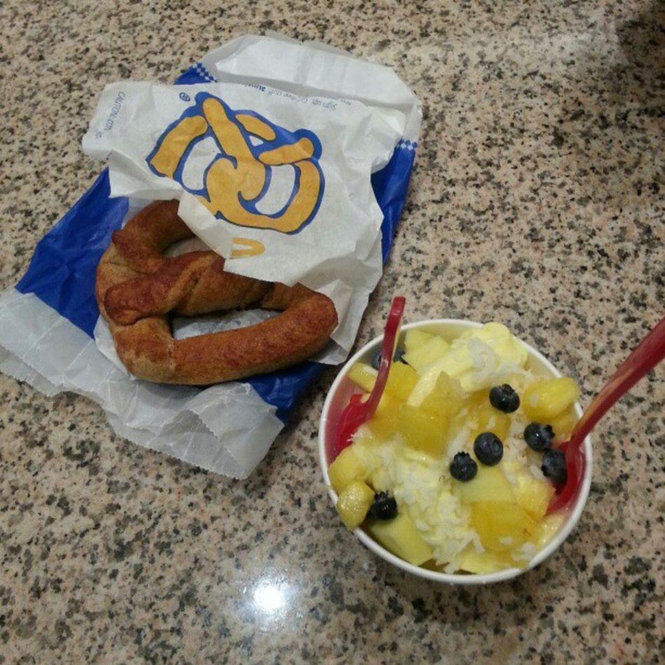 Nom nom nom. Redmango Mango Yogurt with pineapple blueberries coconut shavings and auntieannes pretzel with my girl eno..