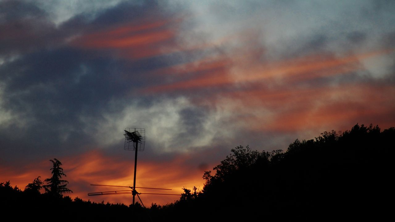sunset, tree, silhouette, orange color, nature, beauty in nature, cloud - sky, sky, low angle view, tranquil scene, scenics, tranquility, dramatic sky, no people, outdoors, growth, electricity pylon, day