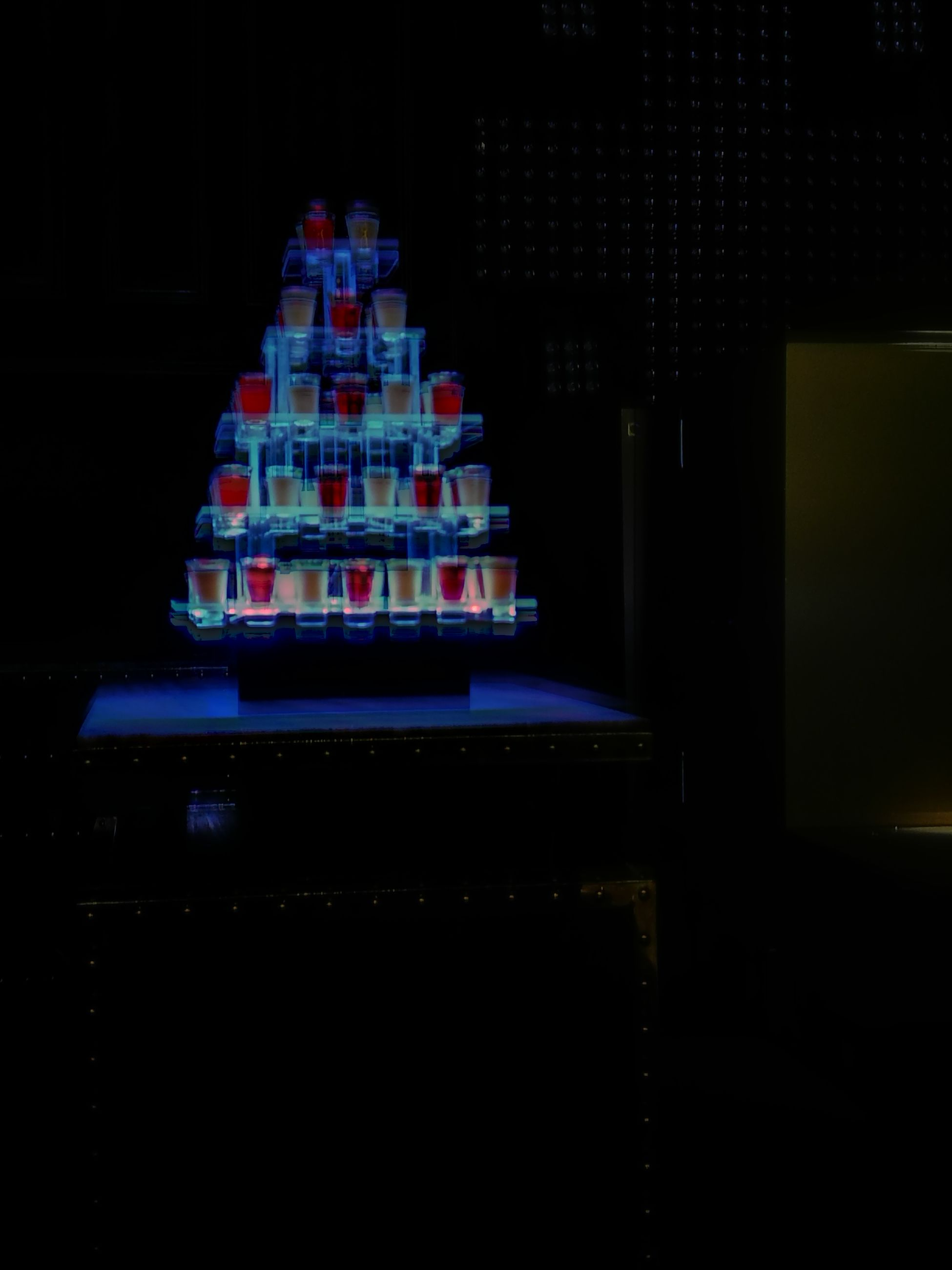 stack, indoors, no people, large group of objects, black background, night