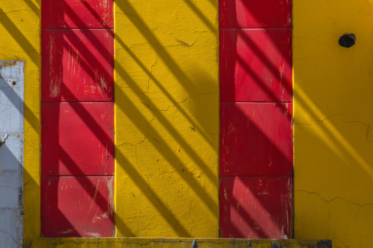 Architecture Backgrounds Close-up Day Full Frame Ligth And Shadow Multi Colored No People Outdoors Powder Paint Red Yellow