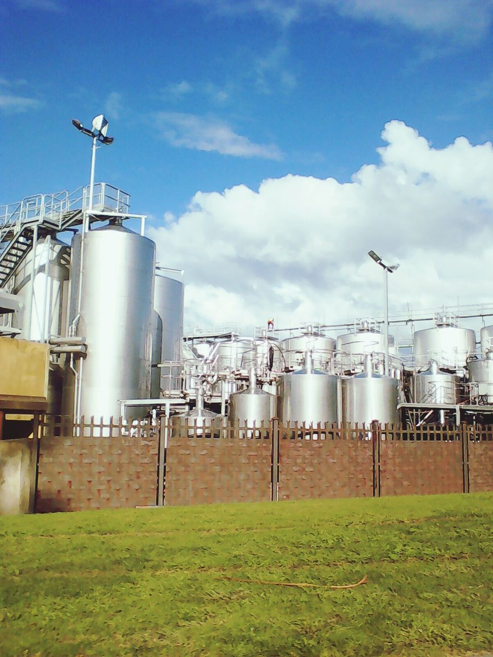 sky, storage tank, no people, industry, factory, day, fuel and power generation, outdoors, grass