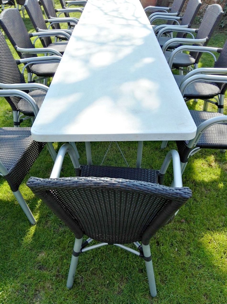 White table with chairs Chair No People Outdoors Grass Day White Table Long Table Long Table Setting Italian Restaurant Italianstyle Many Chairs Eating With Friends Eating With Co-workers Eating With Family