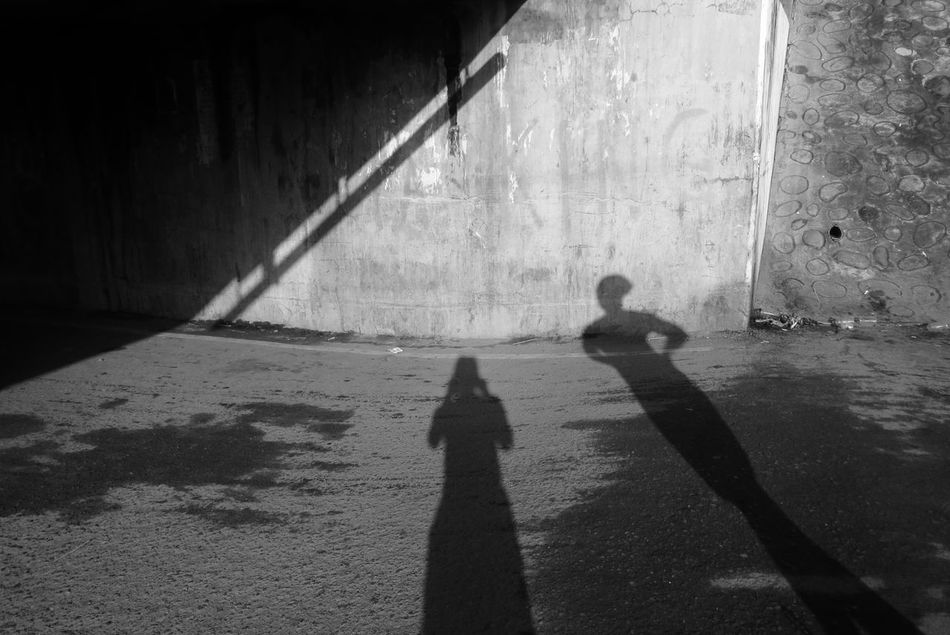 The Oscars award goes toooo..... Day EyeEm Pampanga Eyeem Philippines Focus On Shadow Human Representation Monocrome Photography Outdoors Shadow Streetphoto_bw Streetphotography Sunlight Togetherness