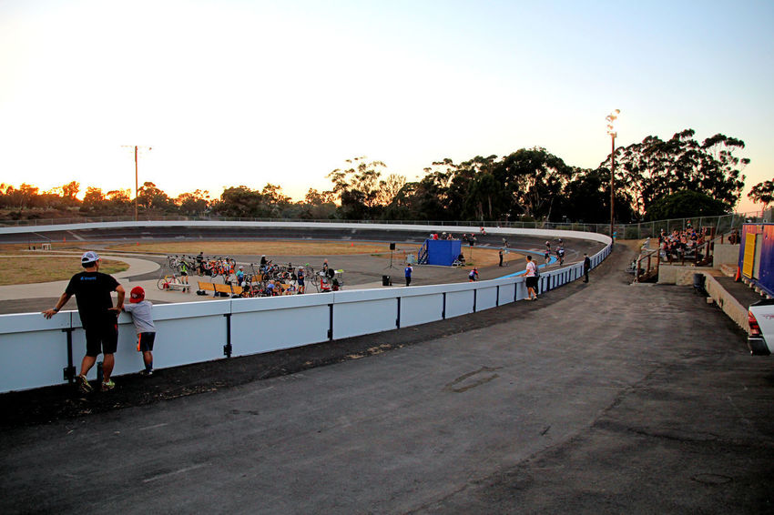 """I feel the need – the need for speed."" Located in the heart of Balboa Park's Morley Field Athletic Complex, the San Diego Velodrome is the resource for bicycle track racing in the greater San Diego area. One of three velodromes in the Southwestern United States, the San Diego Velodrome is a premiere training and racing destination. Development programs are tailored for riders of all ages, skills, and abilities. The San Diego Velodrome offers one of the longest race schedules in the US, and the San Diego Velodrome Association fosters grass-roots racers through National and Olympic-level riders. Constructed in 1976, the San Diego Velodrome flourishes through the management of the San Diego Velodrome Association. With 28 degree banked corners, this 333.3 meter (364.5 yds) oval track is a recreational and racing resource unlike anything else in Southern California. Velodrome, Bicycle Racing, Fixed Gear Bike, Bicycle, Riders, Oval Track, San Diego, California, Balboa Park, Morley Field, Evening, Night,"