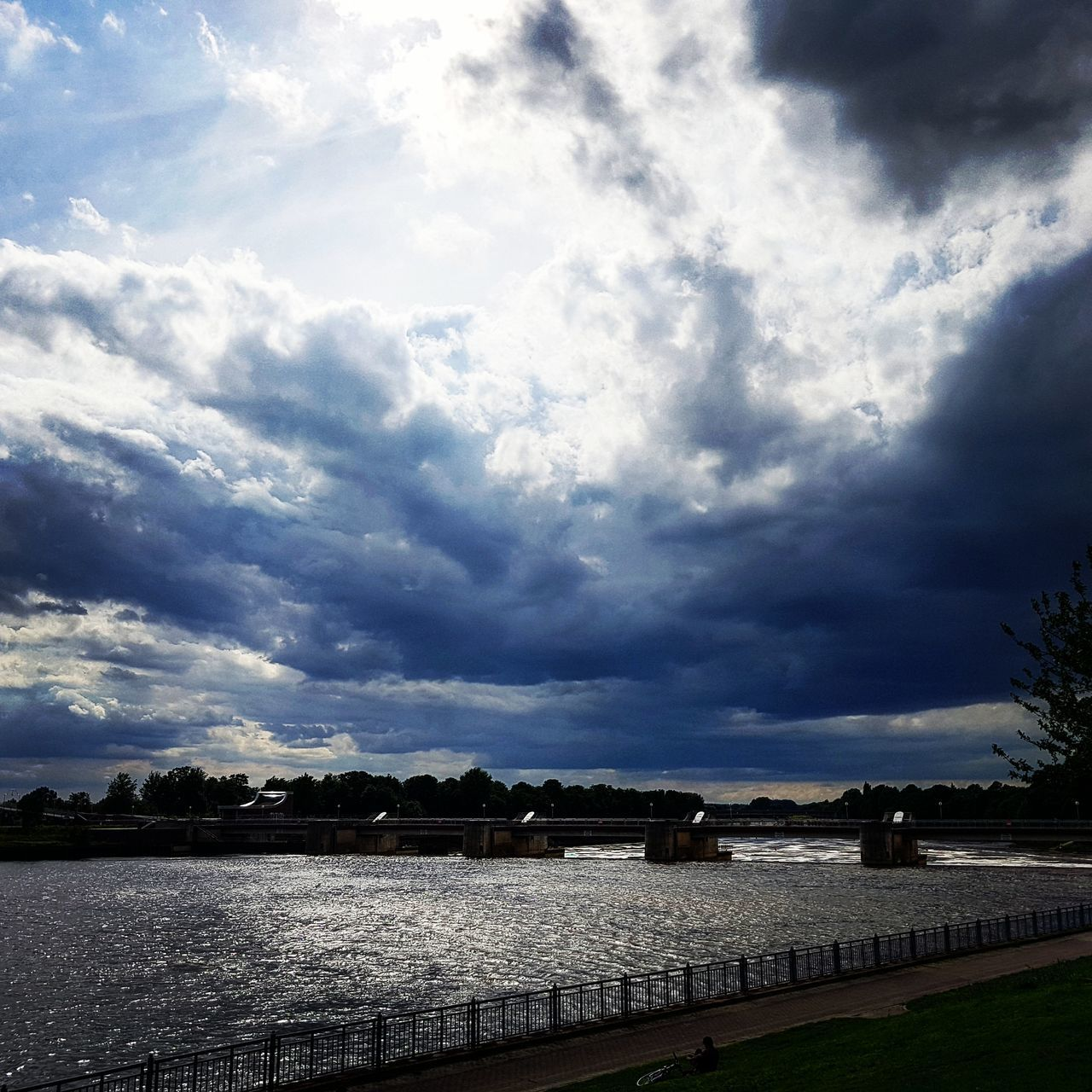 cloud - sky, sky, water, river, nature, tranquility, weather, tranquil scene, no people, outdoors, scenics, beauty in nature, landscape, day, storm cloud, tree