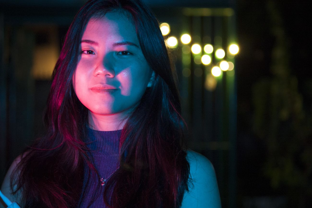 Beautiful Woman Bokeh Close-up Coloured Lights Focus On Foreground Front View Lifestyles Looking At Camera Night Nightphotography One Person One Young Woman Only Outdoors Portrait Real People Red And Blue Redandblue Young Adult Young Women The Portraitist - 2017 EyeEm Awards